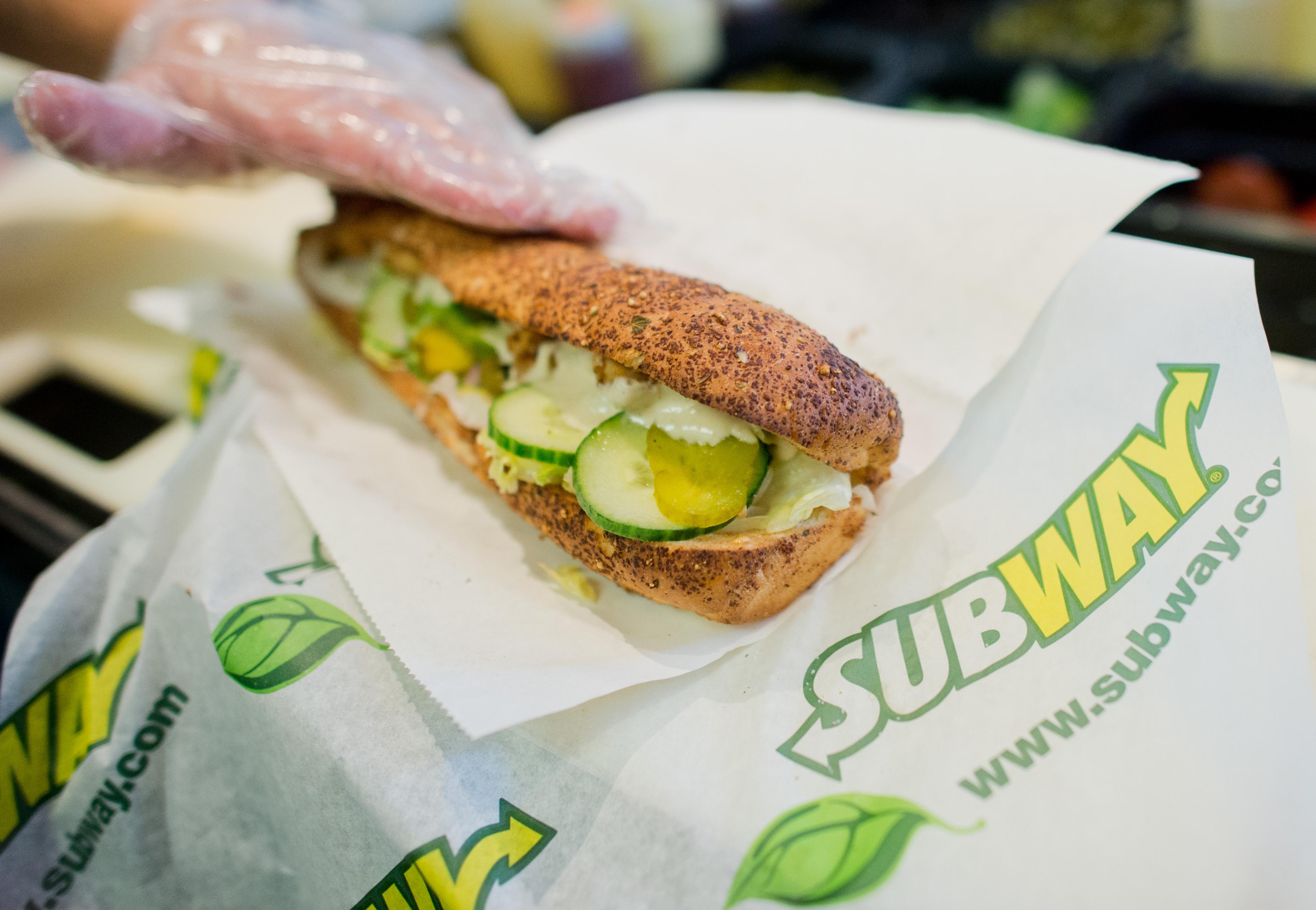Subway sandwich being made