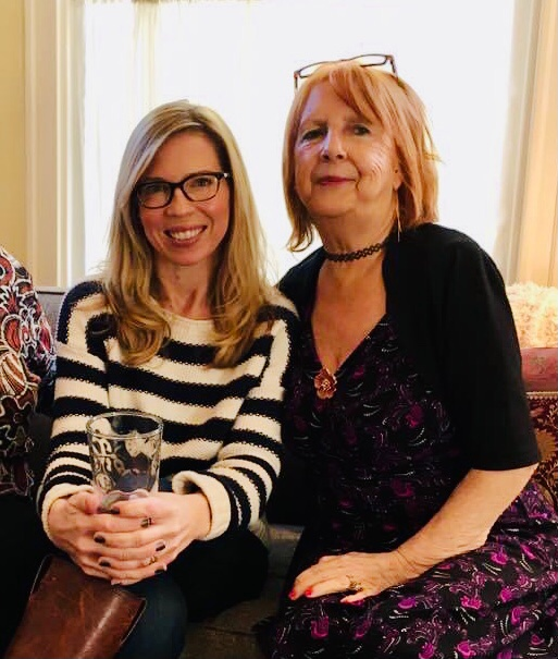 Tanya Stabler Miller, left, and her mother, Priscilla, sit next to each other on a sofa in a November 2019 photo taken at Thanksgiving. Miller scoured the internet trying to find a vaccine appointment for her mom.