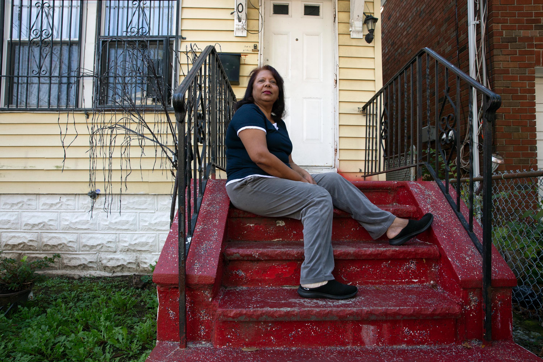 Landlord Surya Hariprasad sits outside her Bronx building, Oct. 15, 2020.