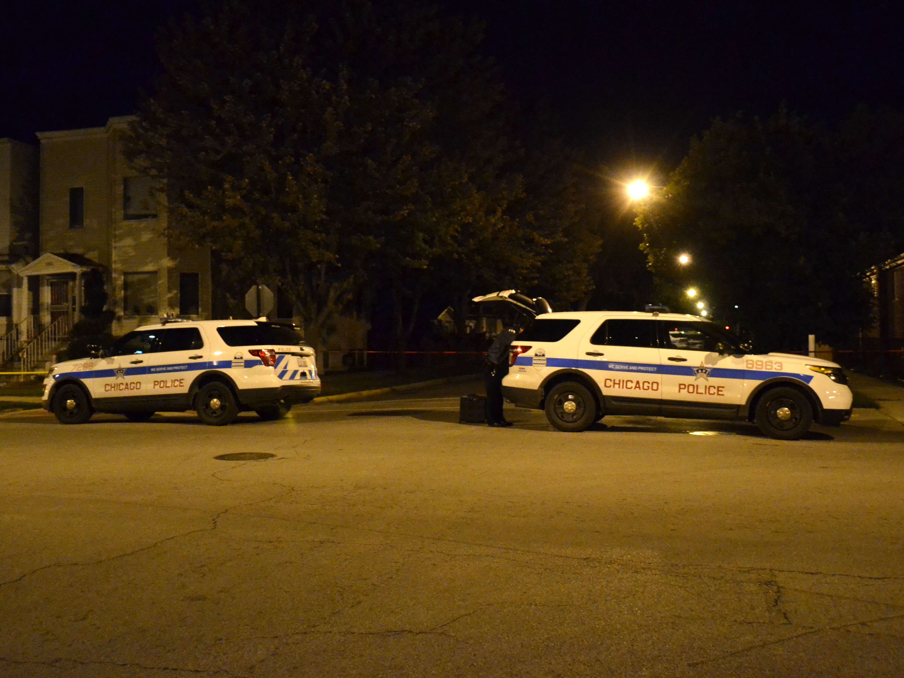 Police investigate a shooting in October 2018 in the 10000 block of South State Street in Chicago's Roseland neighborhood.