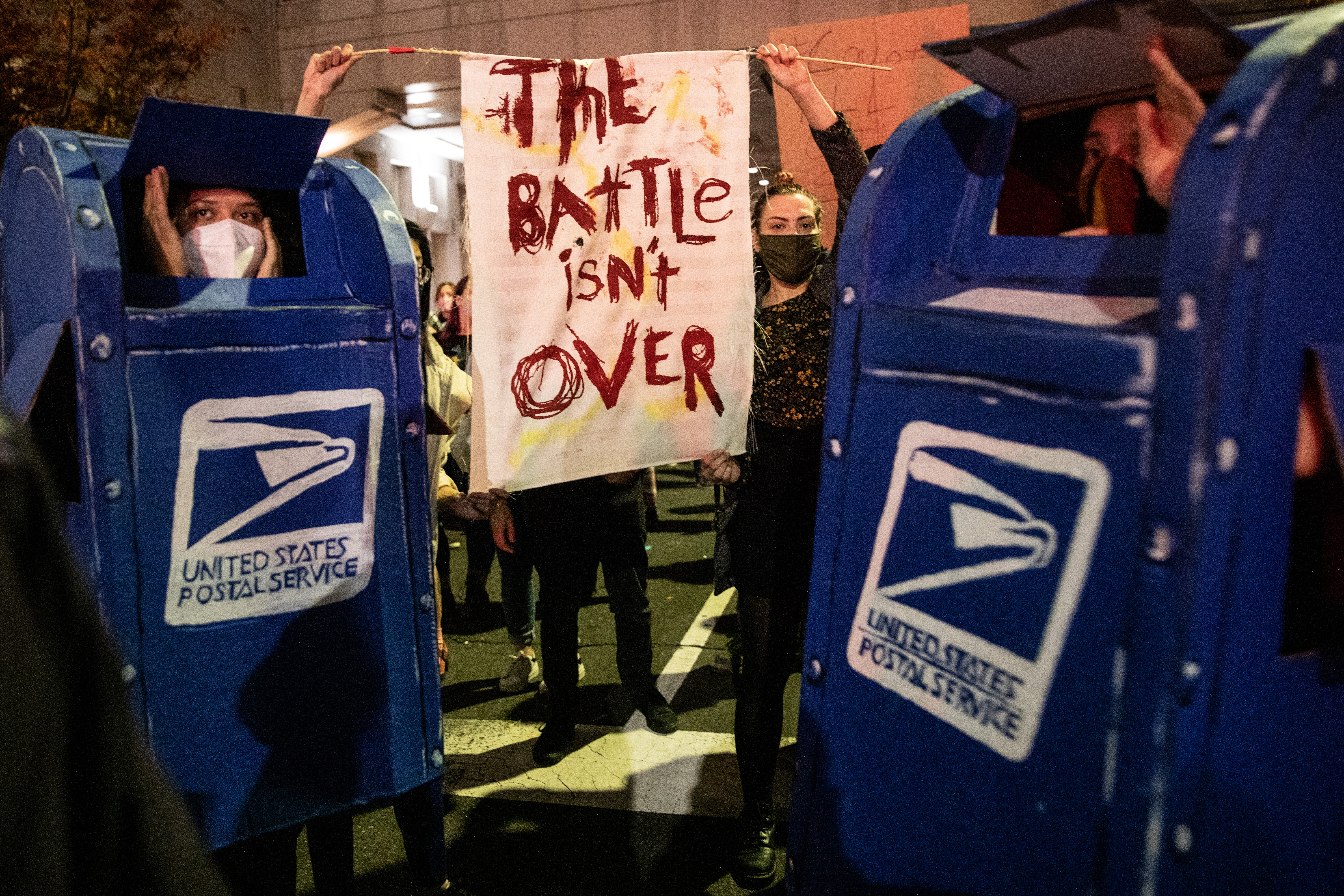 Protestors dressed as USPS drop boxes In Philadelphia during election week 2020.