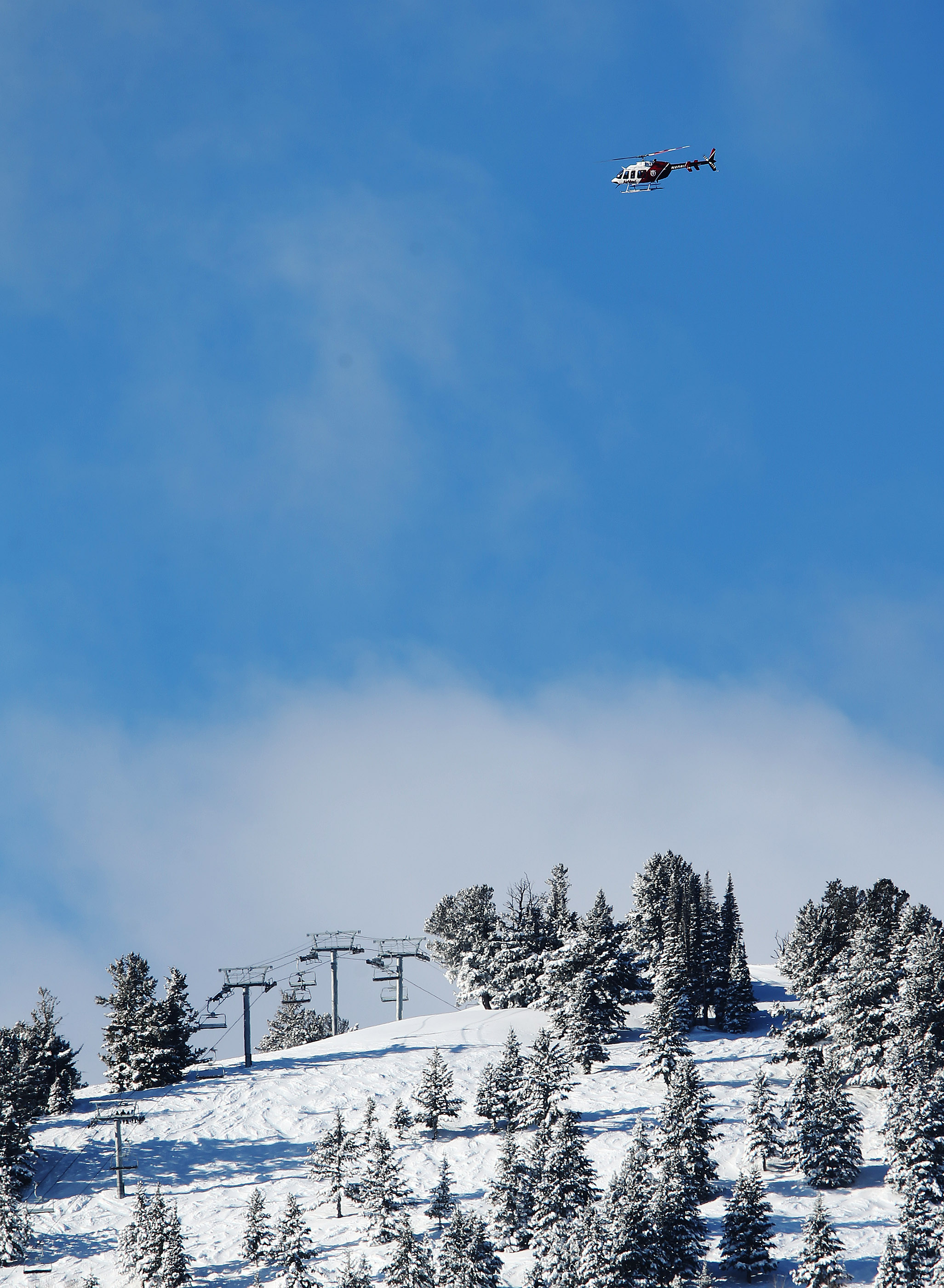 AirMed crews search for a missing skier in the out-of-bounds area near Canyon Village Resort in Park City on Tuesday, Feb. 2, 2016. The skier has been missing since Sunday.