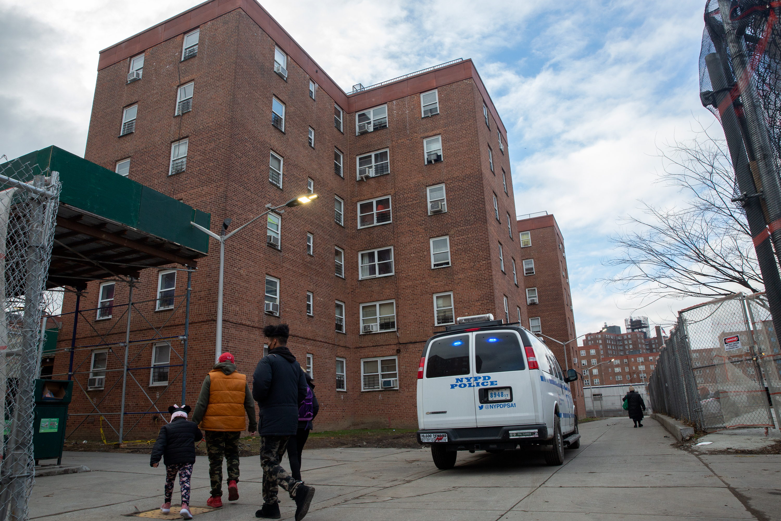 NYPD officers stand watch at the Red Hook Houses in Brooklyn, Jan. 27, 2021.