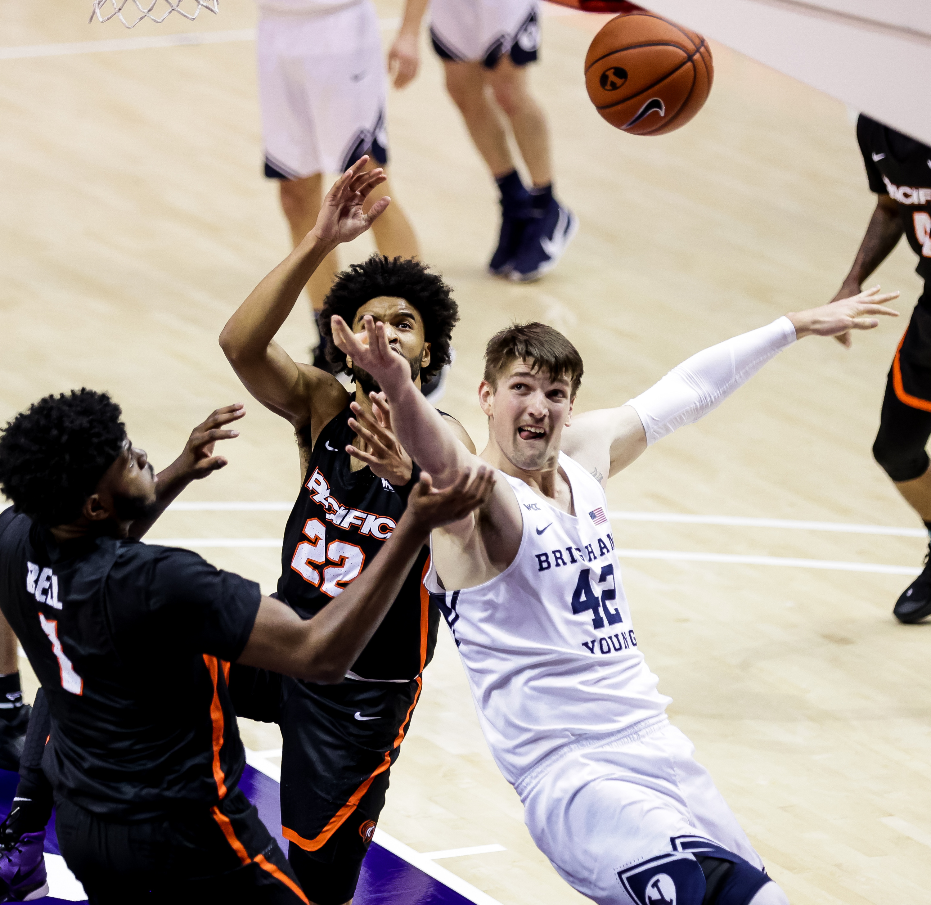 Brigham Young Cougars center Richard Harward (42) tangles with Pacific Tigers forward Jordan Bell (1) and guard Jahbril Price-Noel (22) on a rebound at the Marriott Center in Provo on Saturday, Jan. 30, 2021.