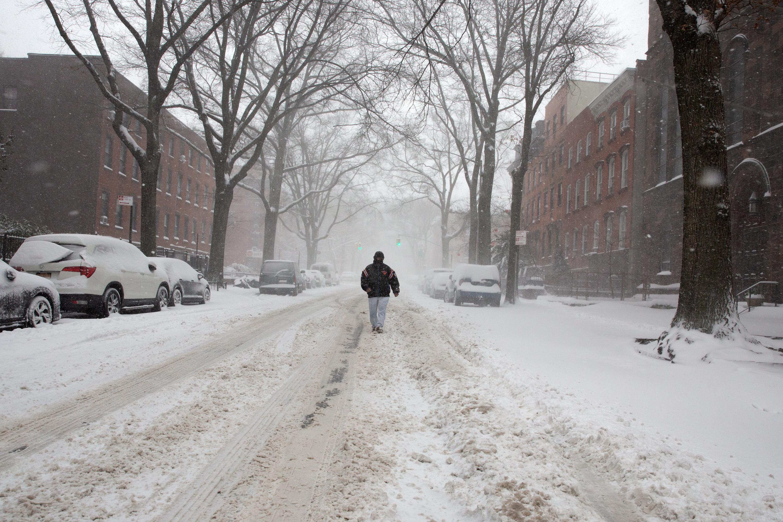 A man walks down the middle of Lafayette Avenue in Fort Greene, Brooklyn, Feb. 1, 2021.