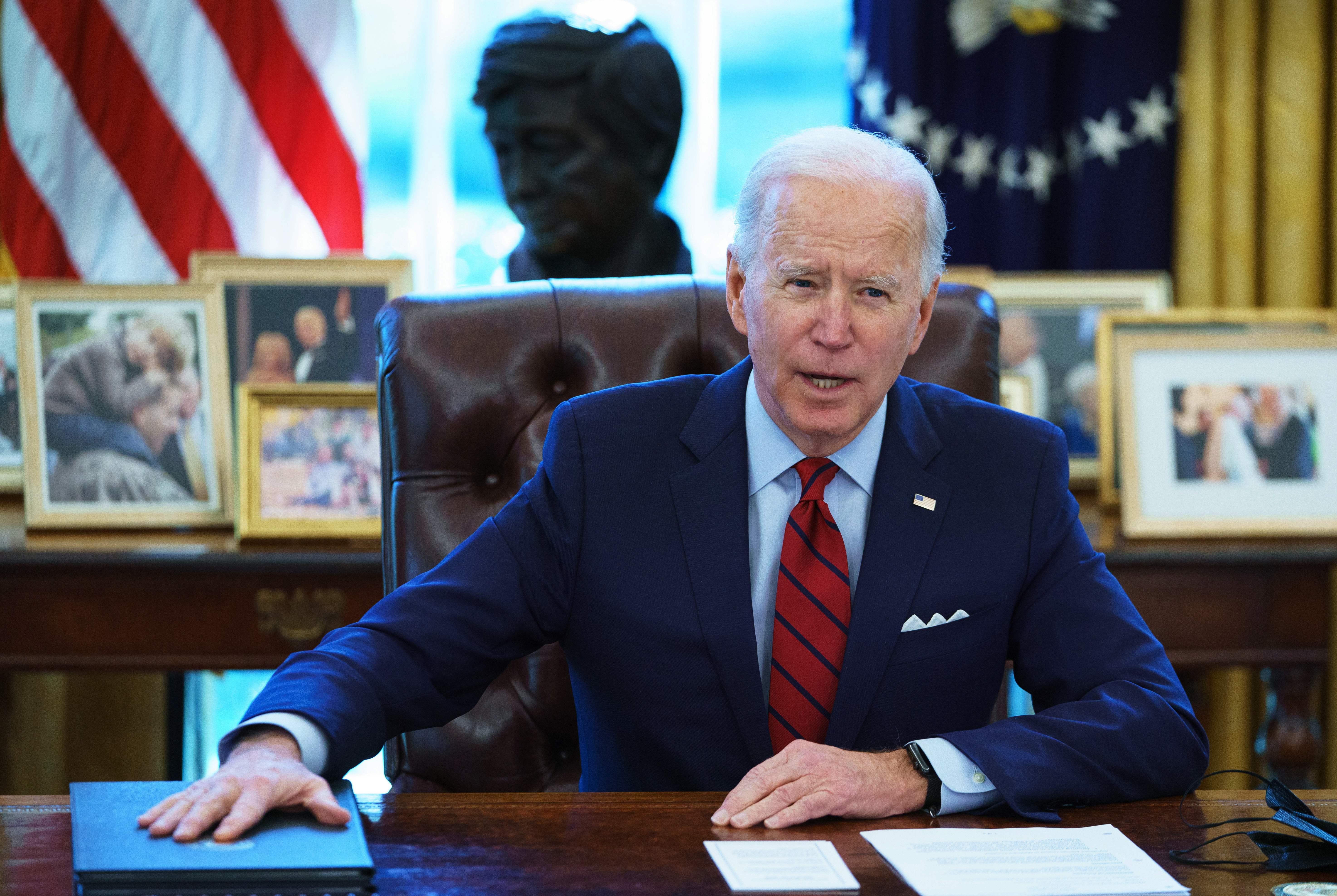 President Joe Biden speaks at the Oval Office in the White House on January 28, 2021.