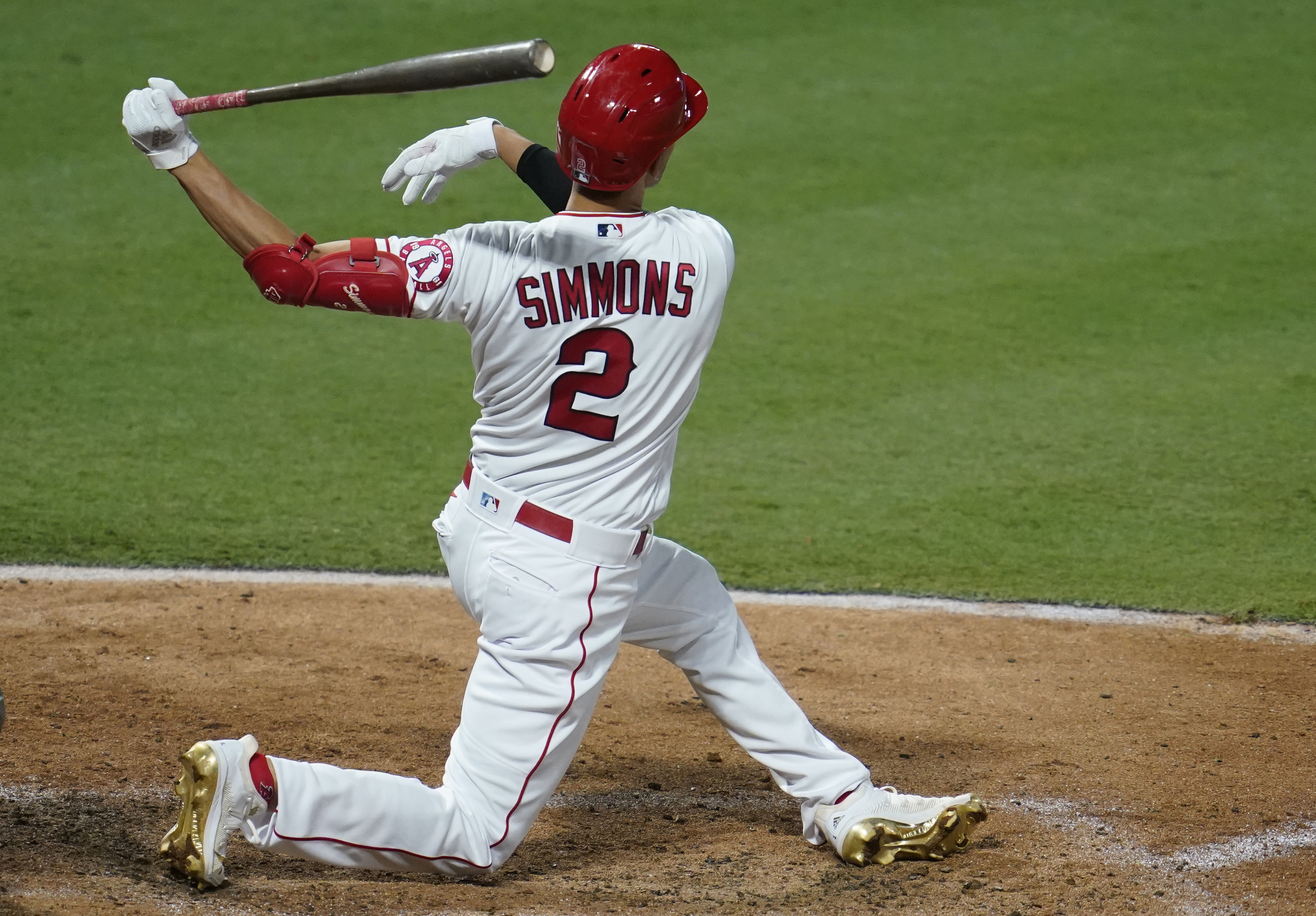 Andrelton Simmons #2 of the Los Angeles Angels gets a hit against the Arizona Diamondbacks at Angel Stadium of Anaheim on September 16, 2020 in Anaheim, California.