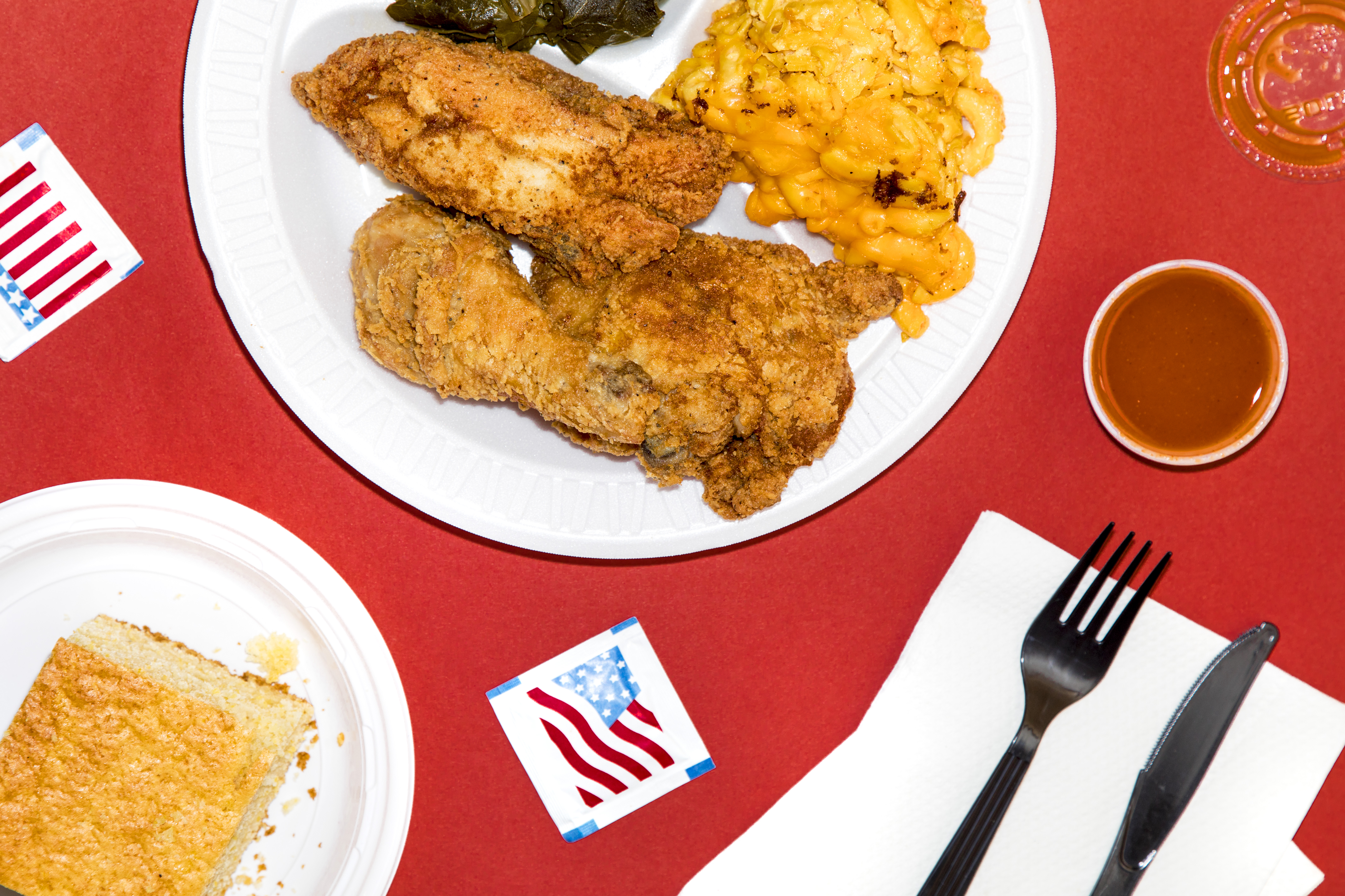 Fried chicken on a plate with two sides