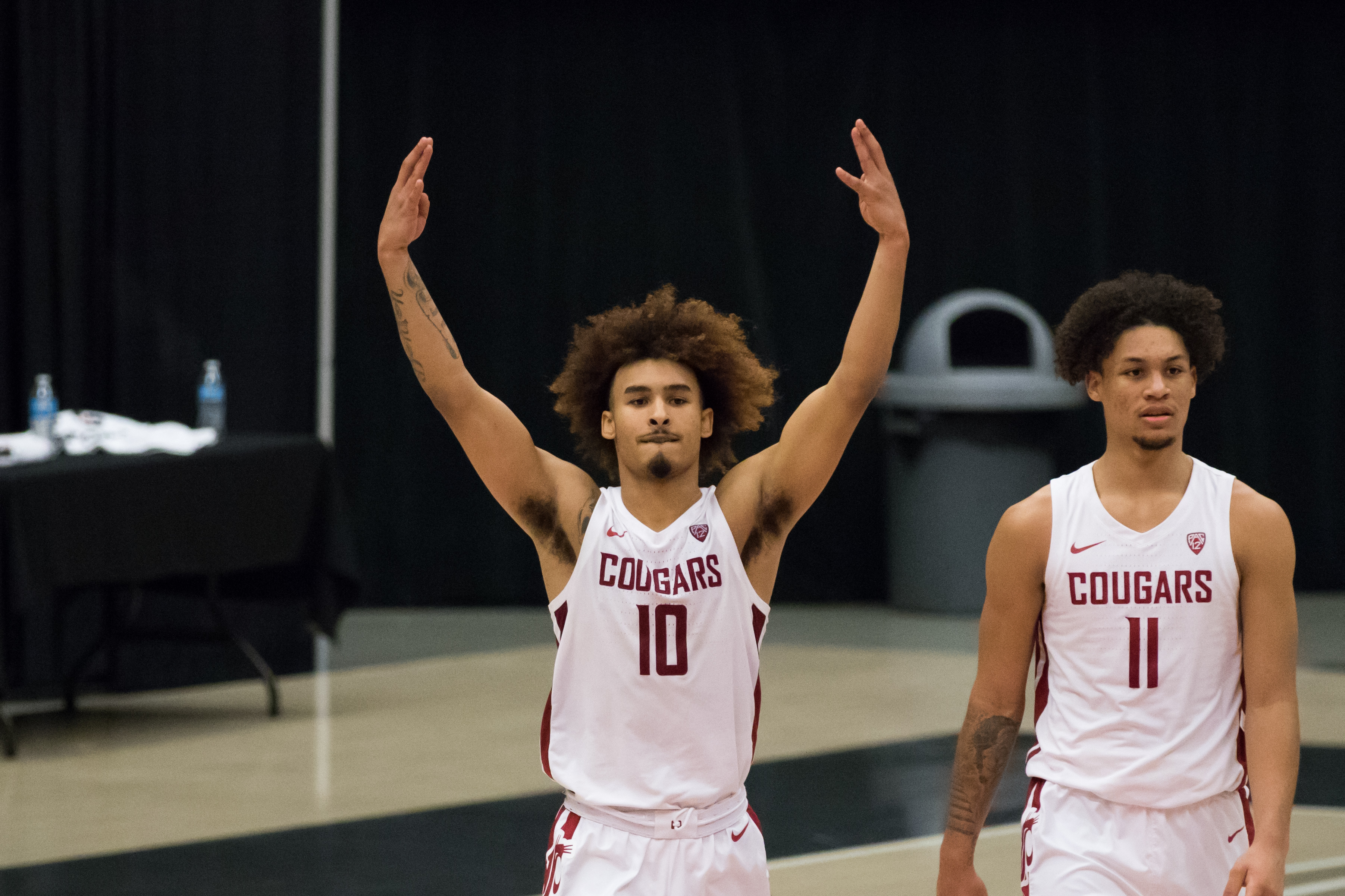 PULLMAN, WA - DECEMBER 2: Washington State guard Isaac Bonton (10) celebrates a 59-55 victory at the conclusion of the Pac 12 matchup between the Oregon State Beavers and the Washington State Cougars on December 2, 2020, at Beasley Coliseum in Pullman, WA.