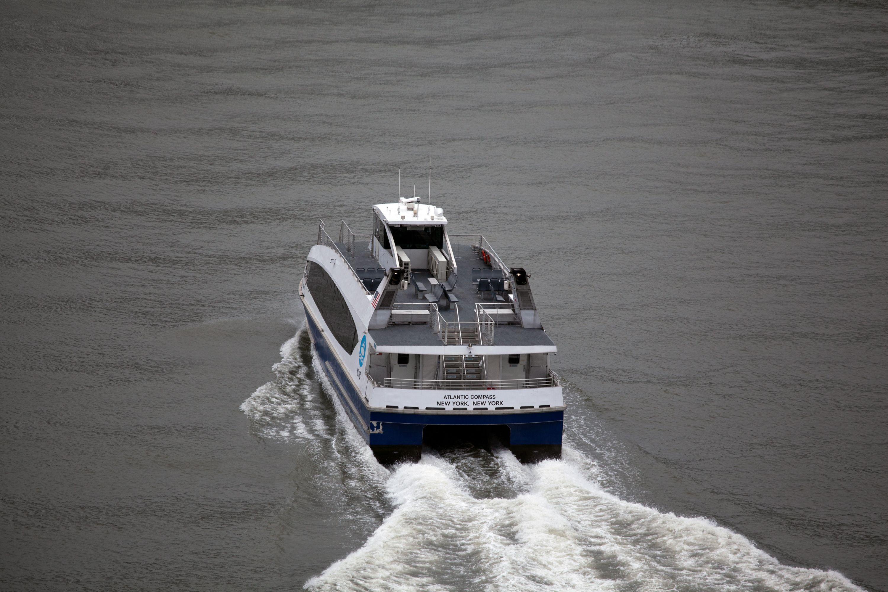 An empty NYC Ferry travels down the East River during the coronavirus outbreak.
