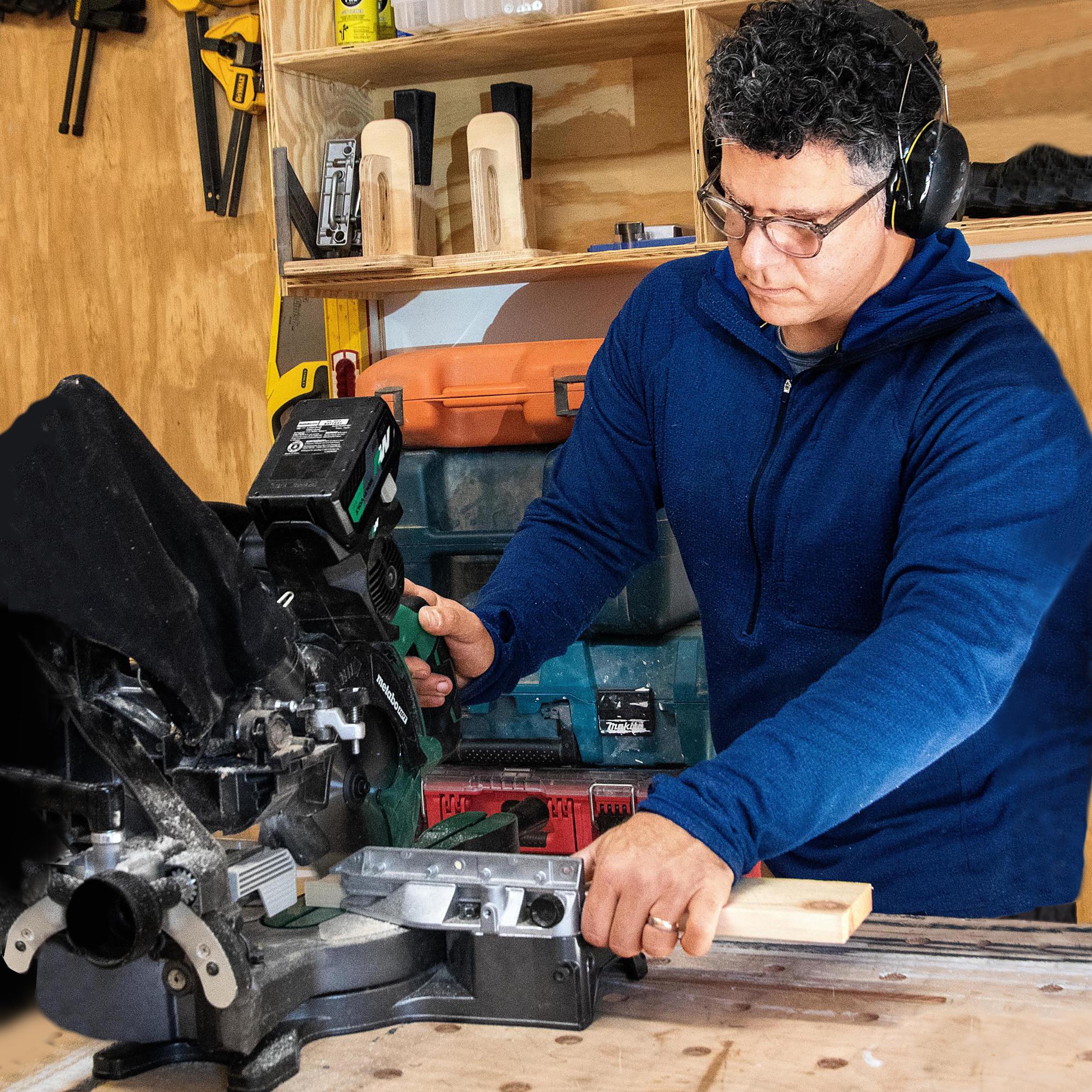 Tool Lab: Sliding Compound-Miter Saws, Spring 2021, Chris Ermides testing a miter saw