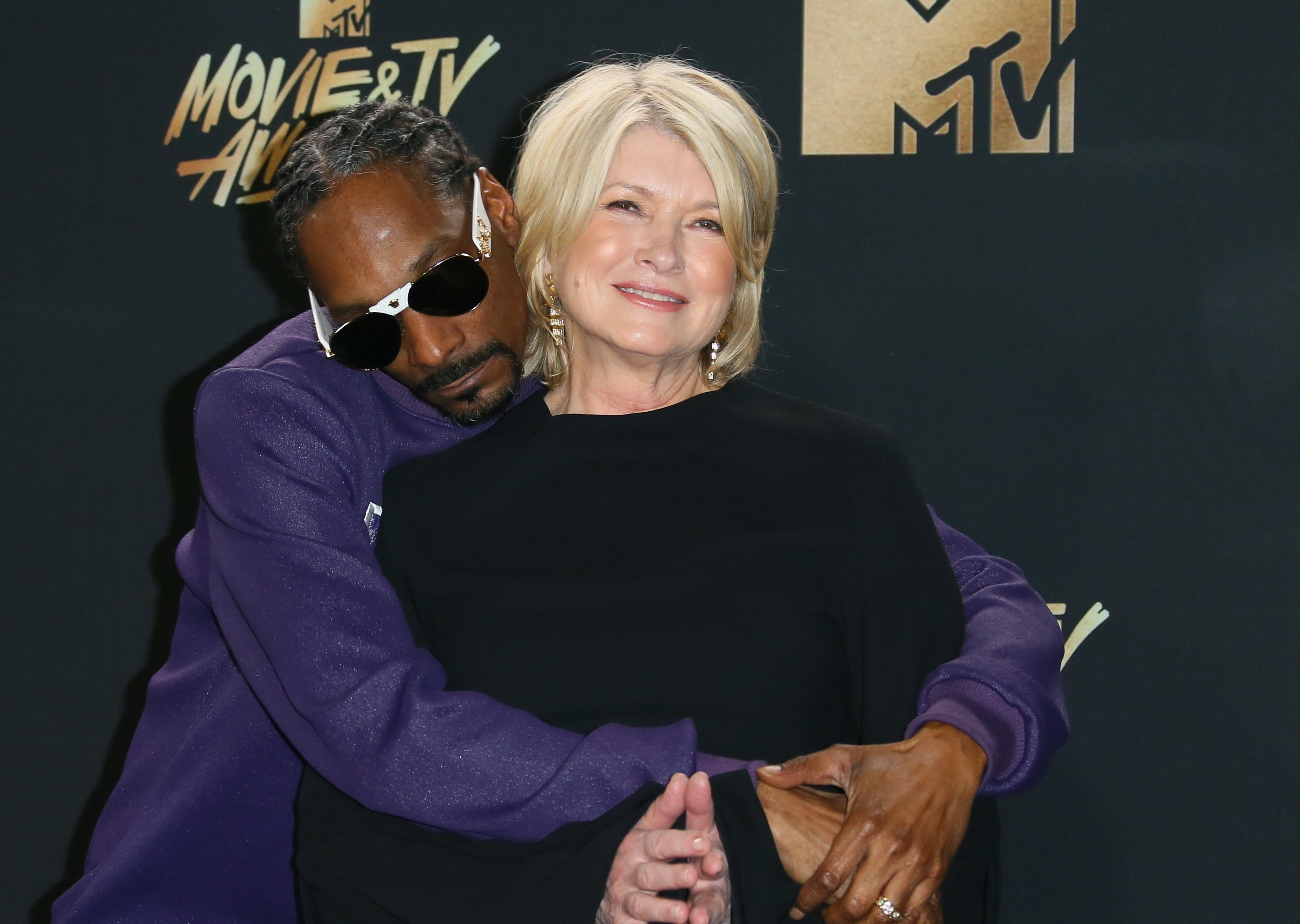 Snoop Dogg and Martha Stewart pose in the press room at the 2017 MTV Movie and TV Awards at The Shrine Auditorium on May 7, 2017 in Los Angeles, California.