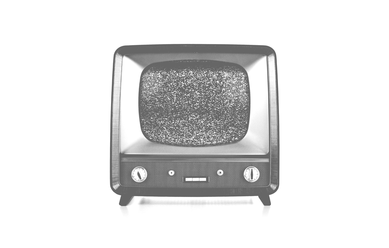 A TV shows a fuzzy screen