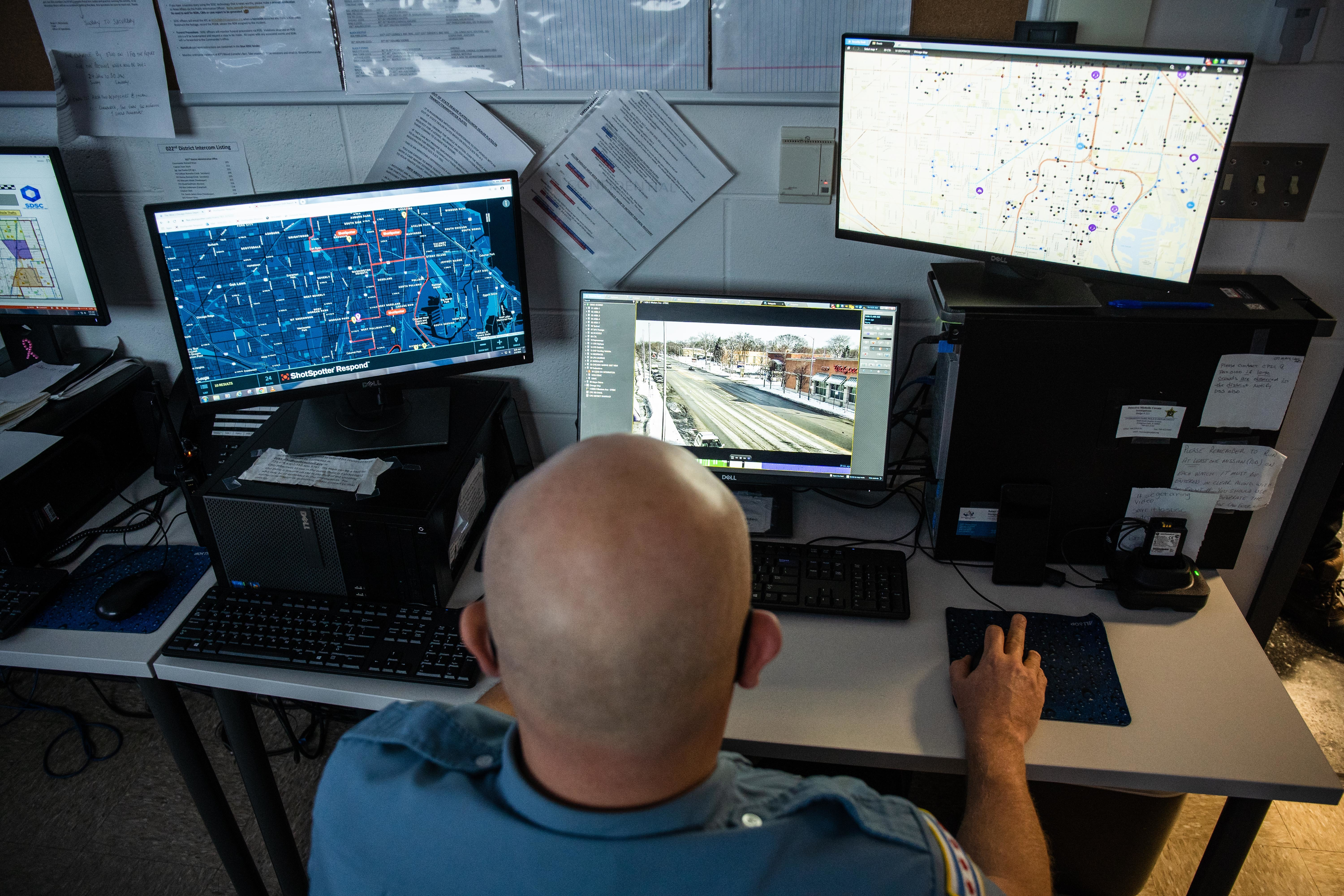 Police officer John Thill monitors cameras placed around the 19th Ward from the Morgan Park District''s Strategic Decision Support Center.