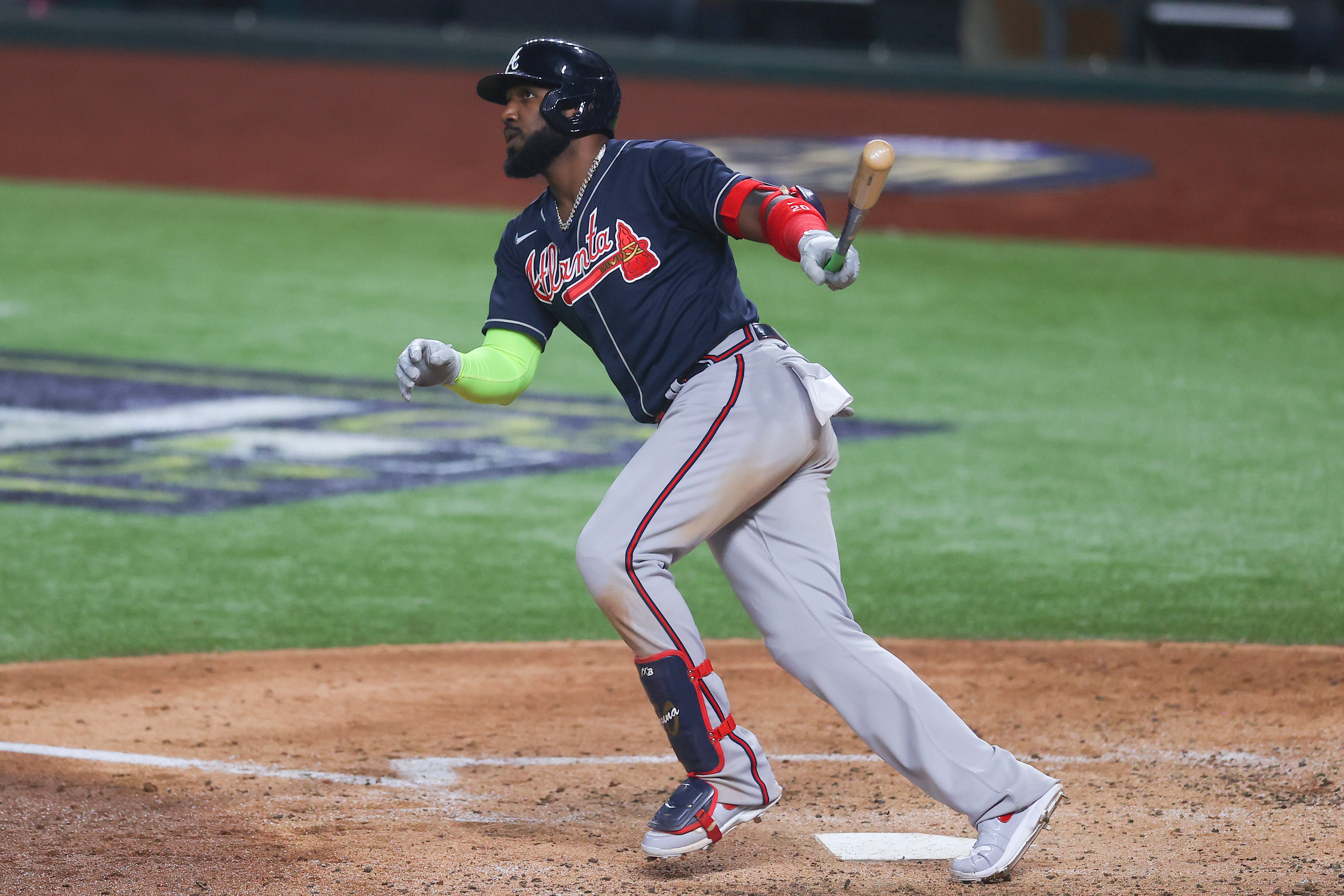 Marcell Ozuna #20 of the Atlanta Braves flies out against the Los Angeles Dodgers during the third inning in Game Seven of the National League Championship Series at Globe Life Field on October 18, 2020 in Arlington, Texas.
