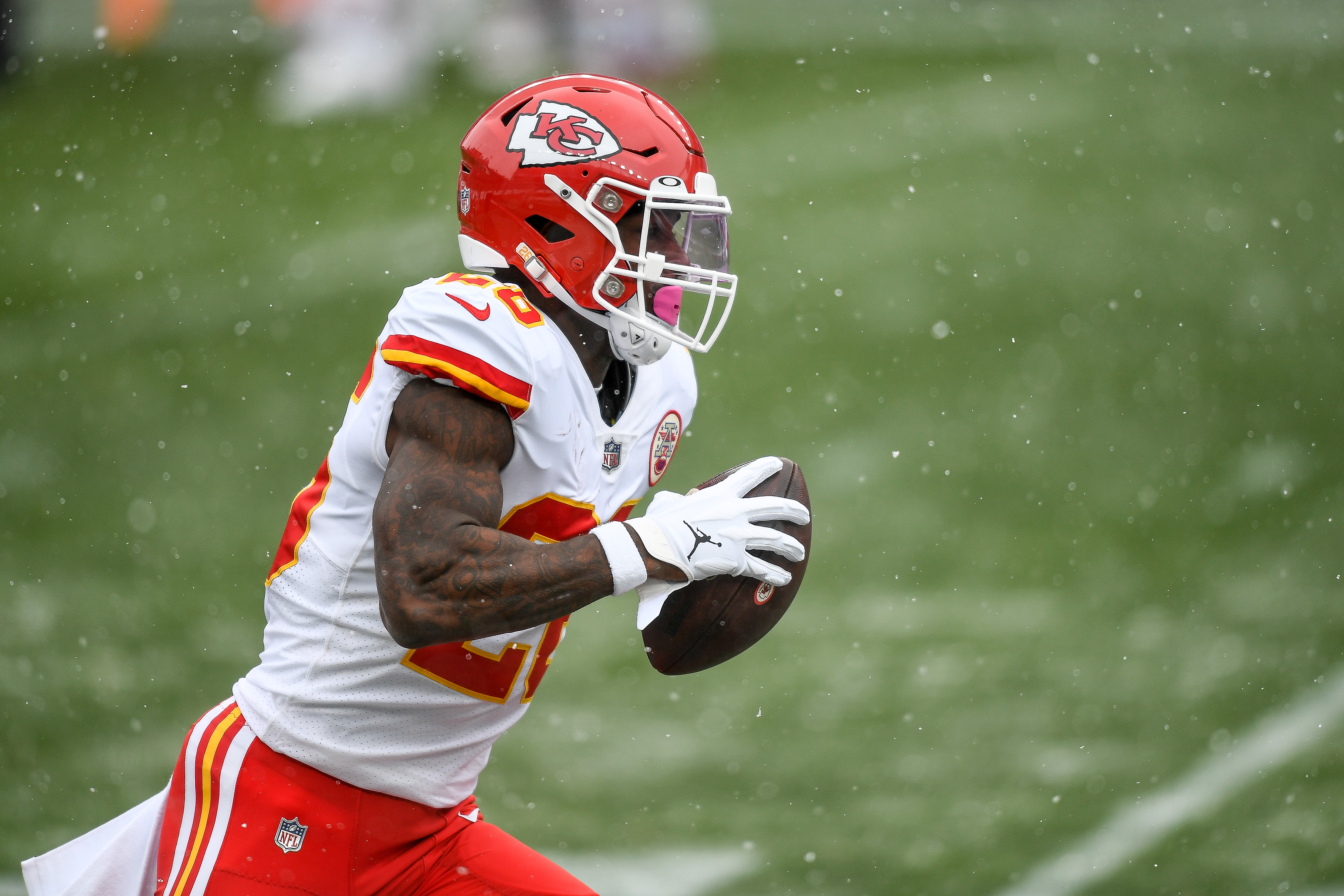 Le'Veon Bell #26 of the Kansas City Chiefs warms up before a game against the Denver Broncos at Empower Field at Mile High on October 25, 2020 in Denver, Colorado.