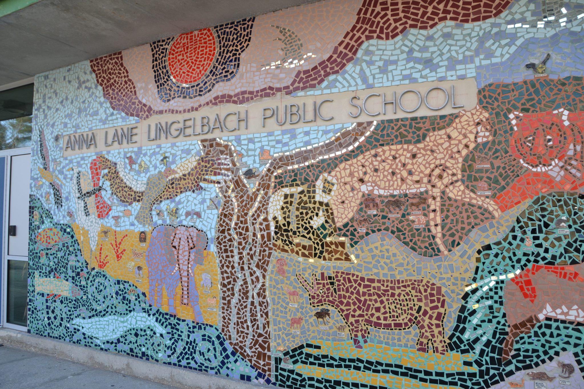 A mosaic wall of a scene of animals at Anna Lane Lingelbach Public School.
