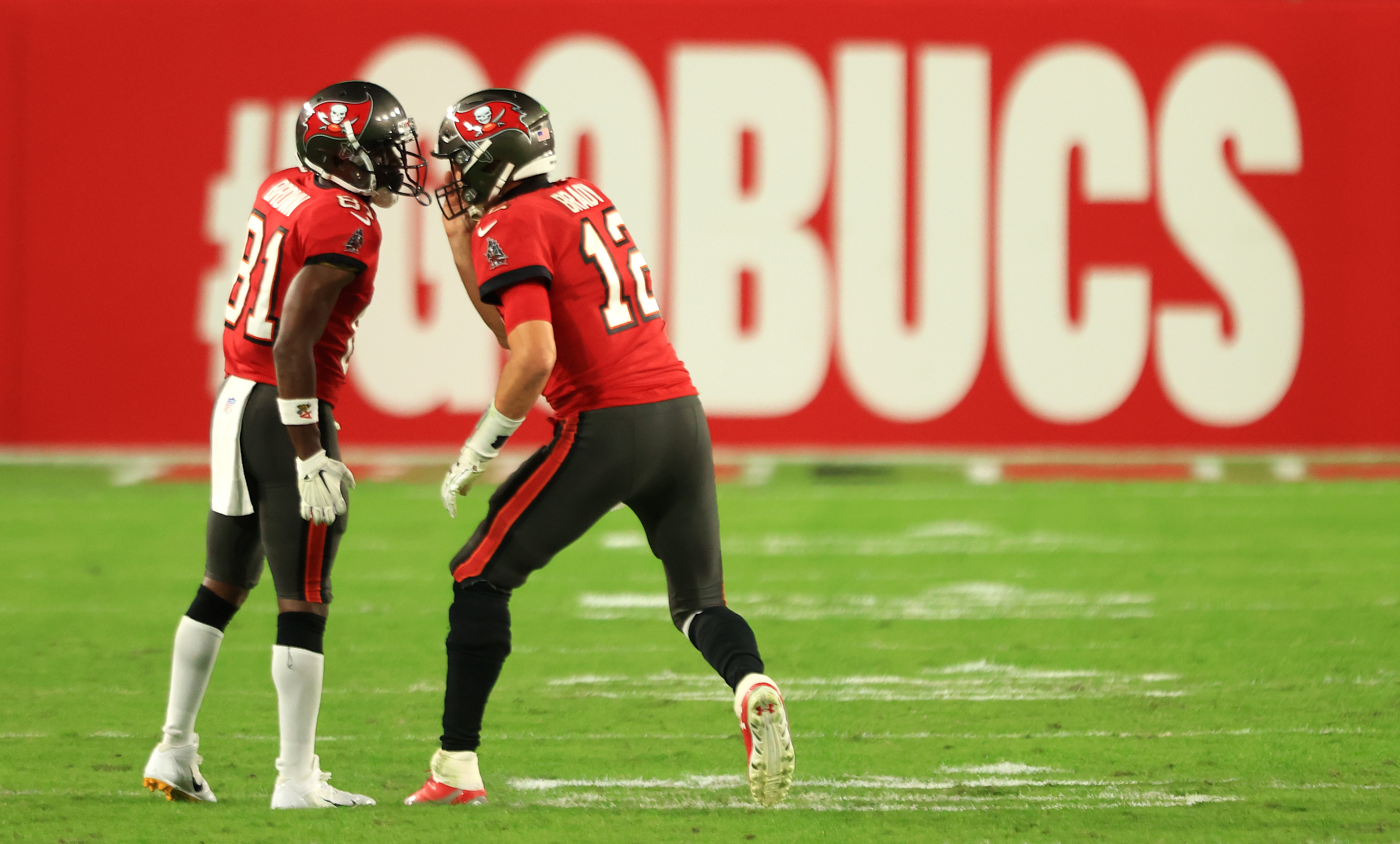 Tom Brady #12 and Antonio Brown #81 of the Tampa Bay Buccaneers speak in the fourth quarter during their game against the Kansas City Chiefs at Raymond James Stadium on November 29, 2020 in Tampa, Florida.
