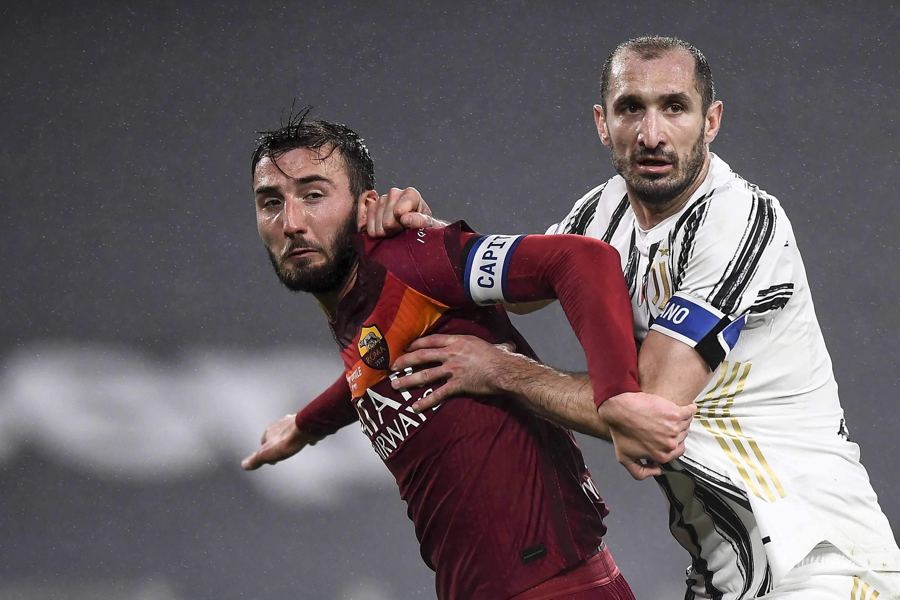 Bryan Cristante (L) of AS Roma competes with Giorgio...