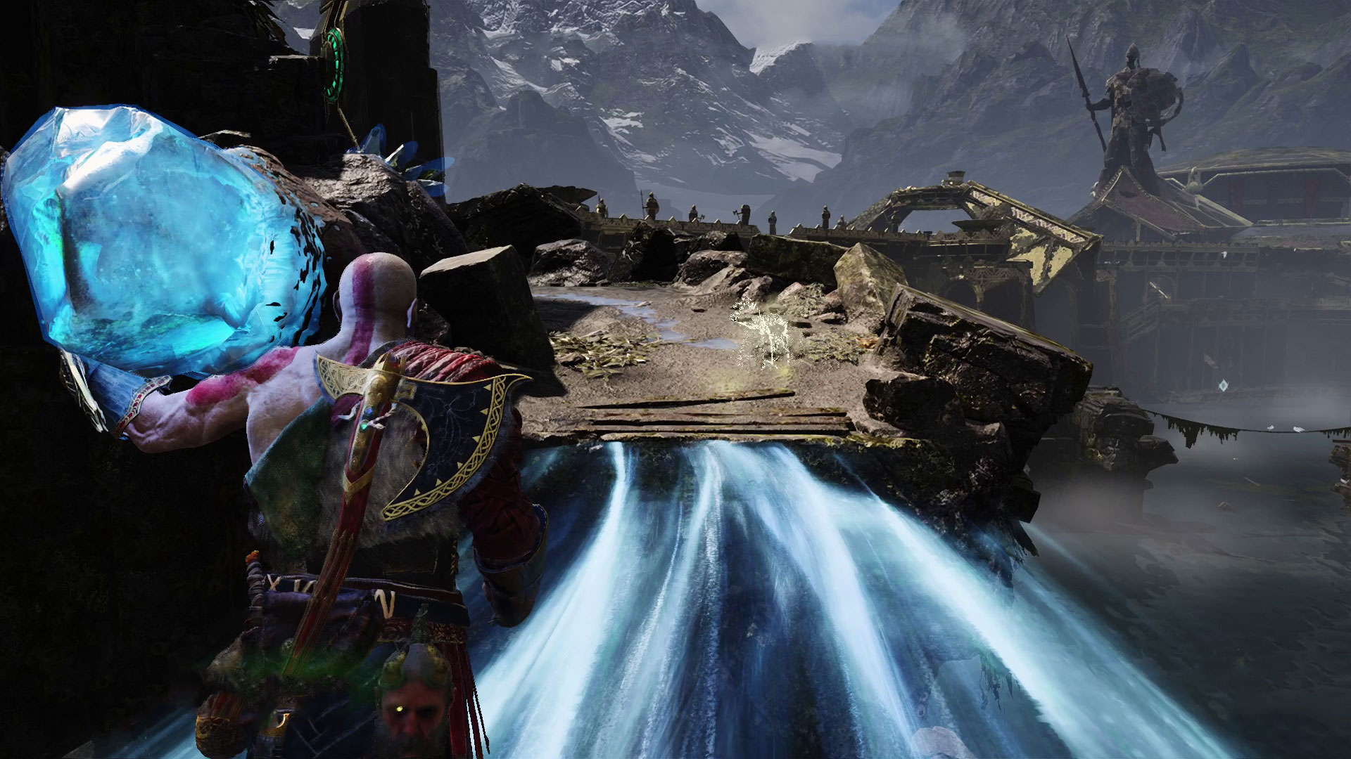 Kratos carrying a crystal on Light Elf Outpost in God of War