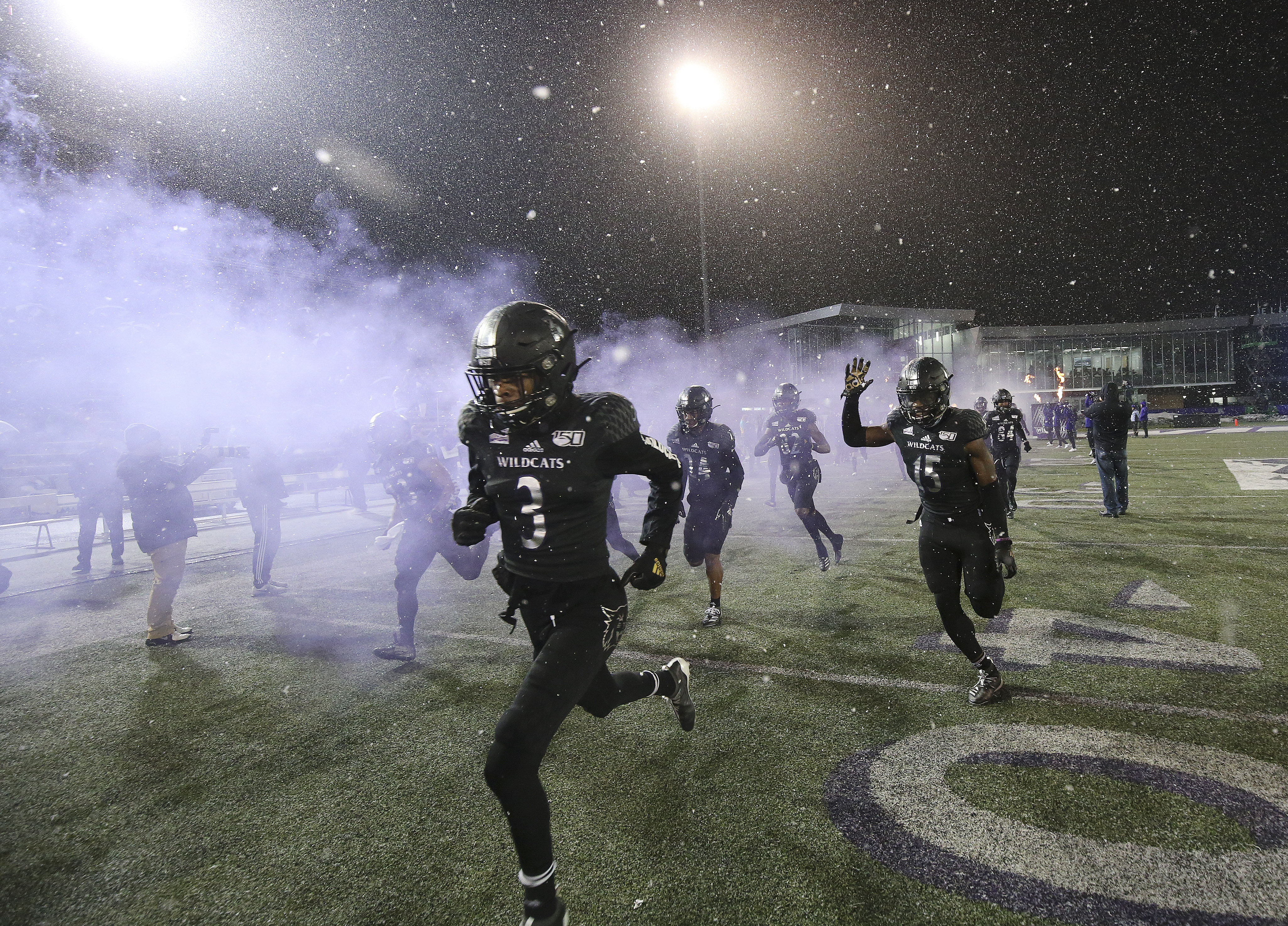 The Weber State Wildcats take the field during the FCS quarterfinals at Stewart Stadium in Ogden on Friday, Dec. 13, 2019.