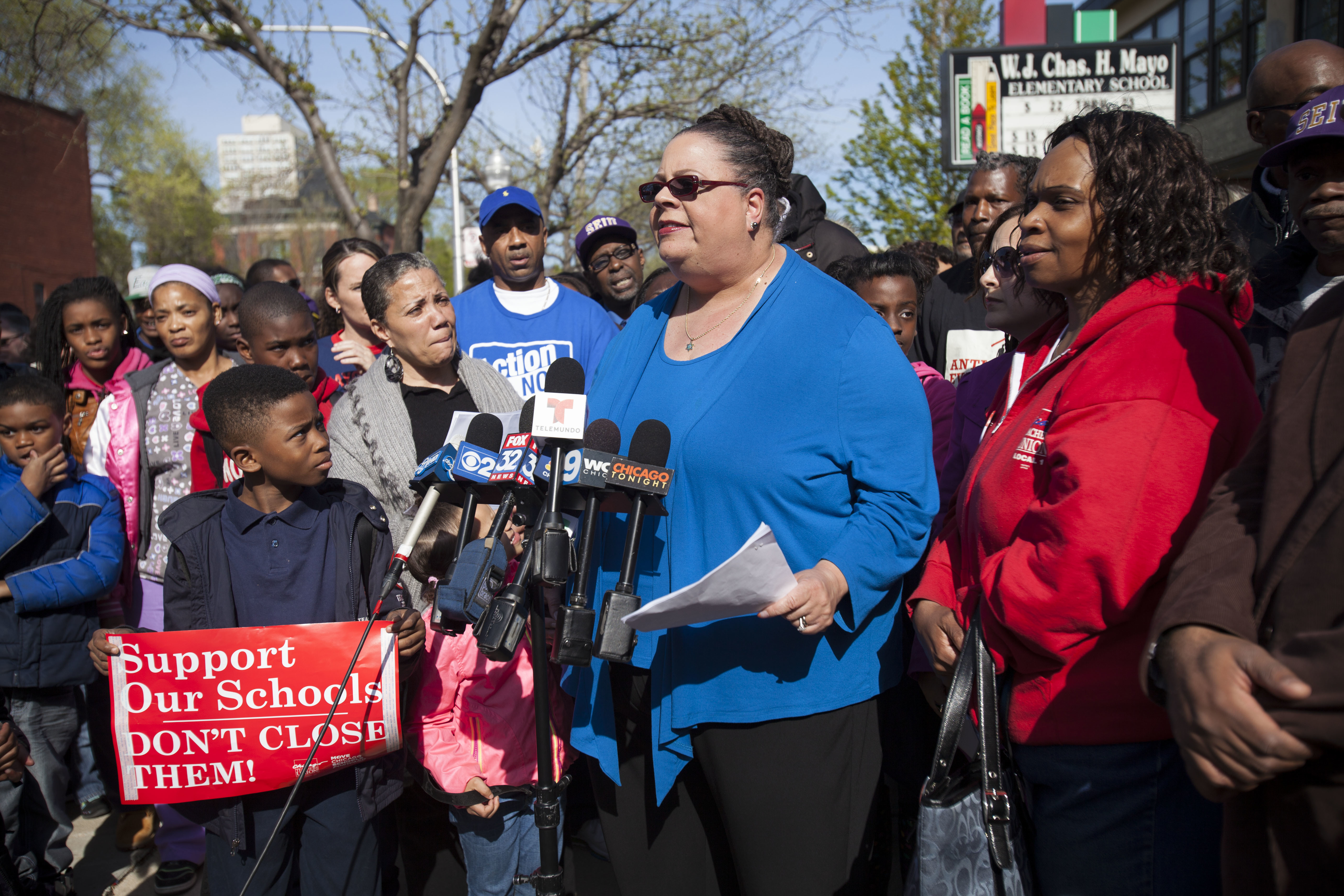 In this photo from May 2013, Chicago Teachers Union President Karen Lewis is shown with parents, labor leaders, activists and students to discuss a march against school closings.