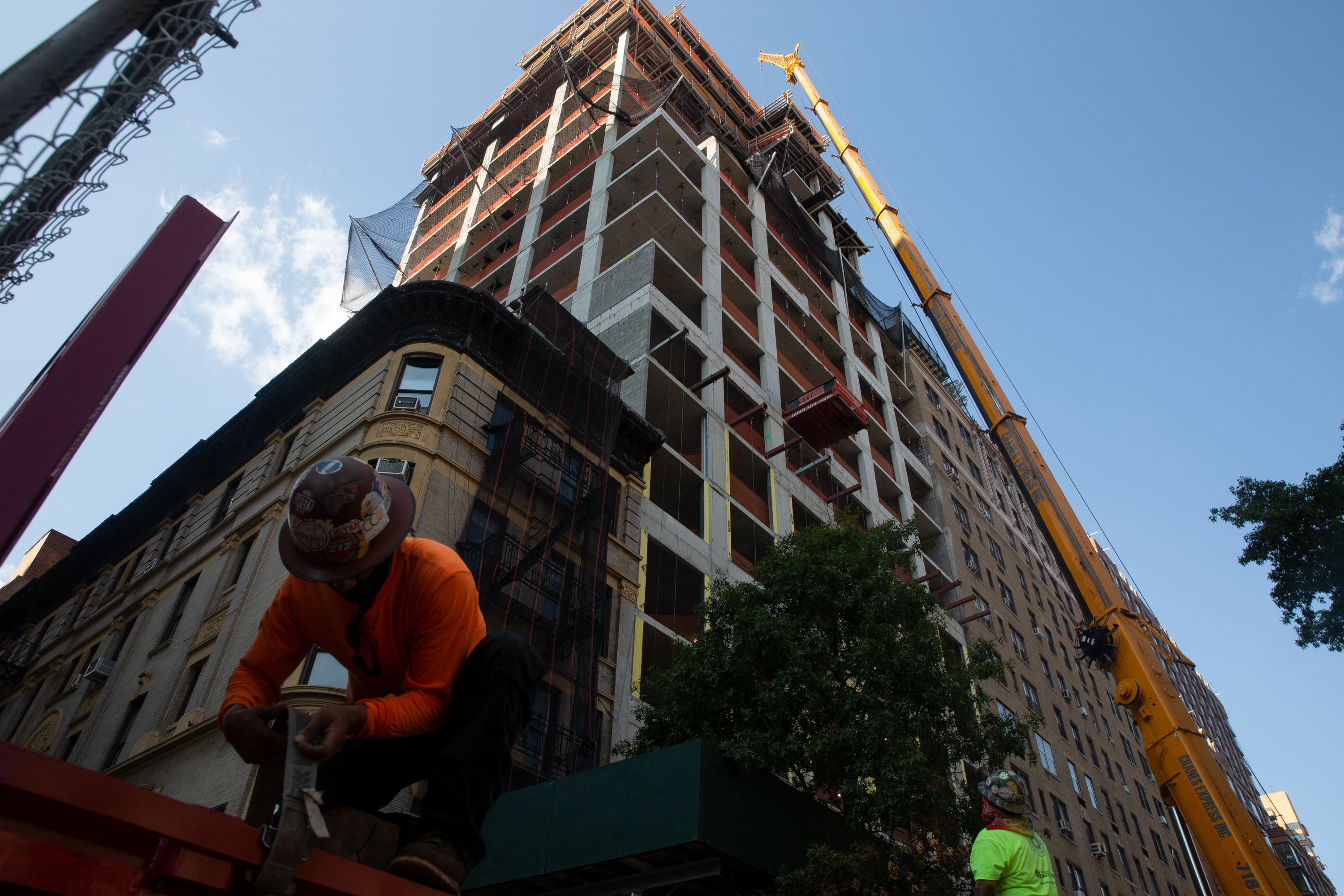 Construction workers help build a new development on the Upper West Side, Sept. 23, 2020.