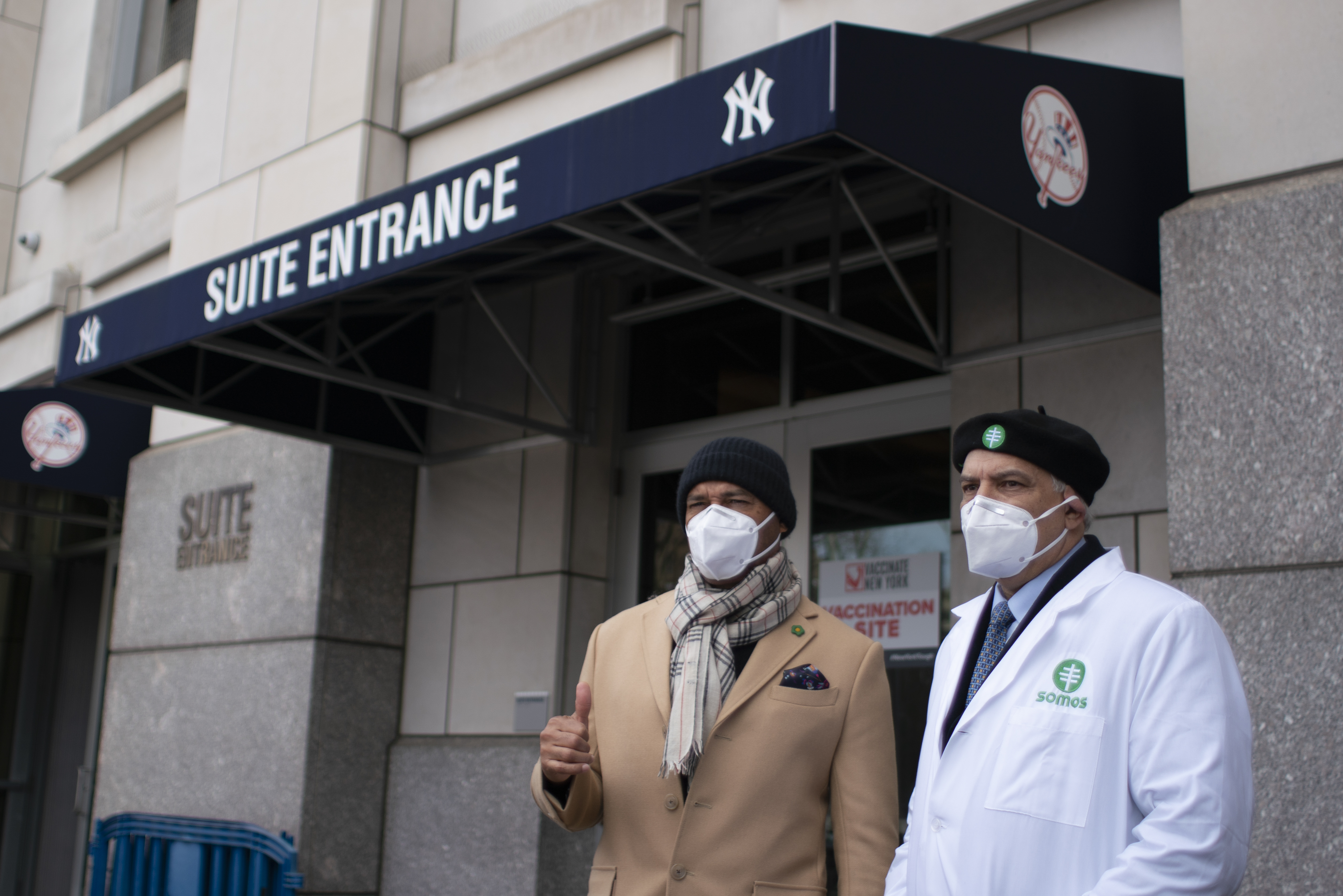 New Yorkers attend opening of COVID-19 vaccine site at Yankee Stadium
