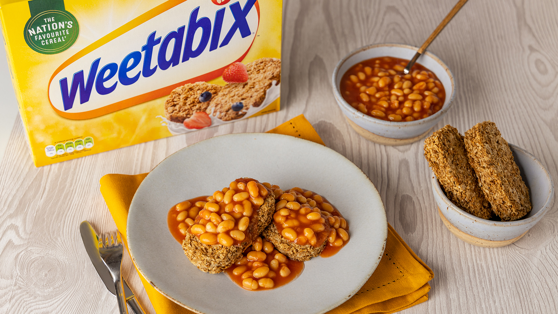 A picture of a plate with Weetabix topped with baked beans