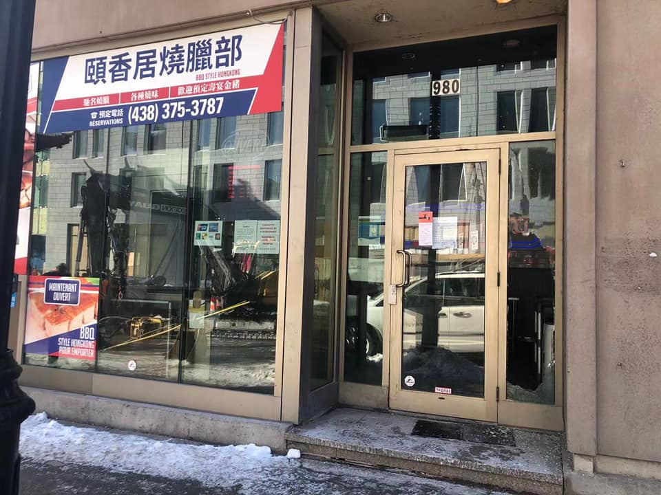 chinatown storefront with shattered window