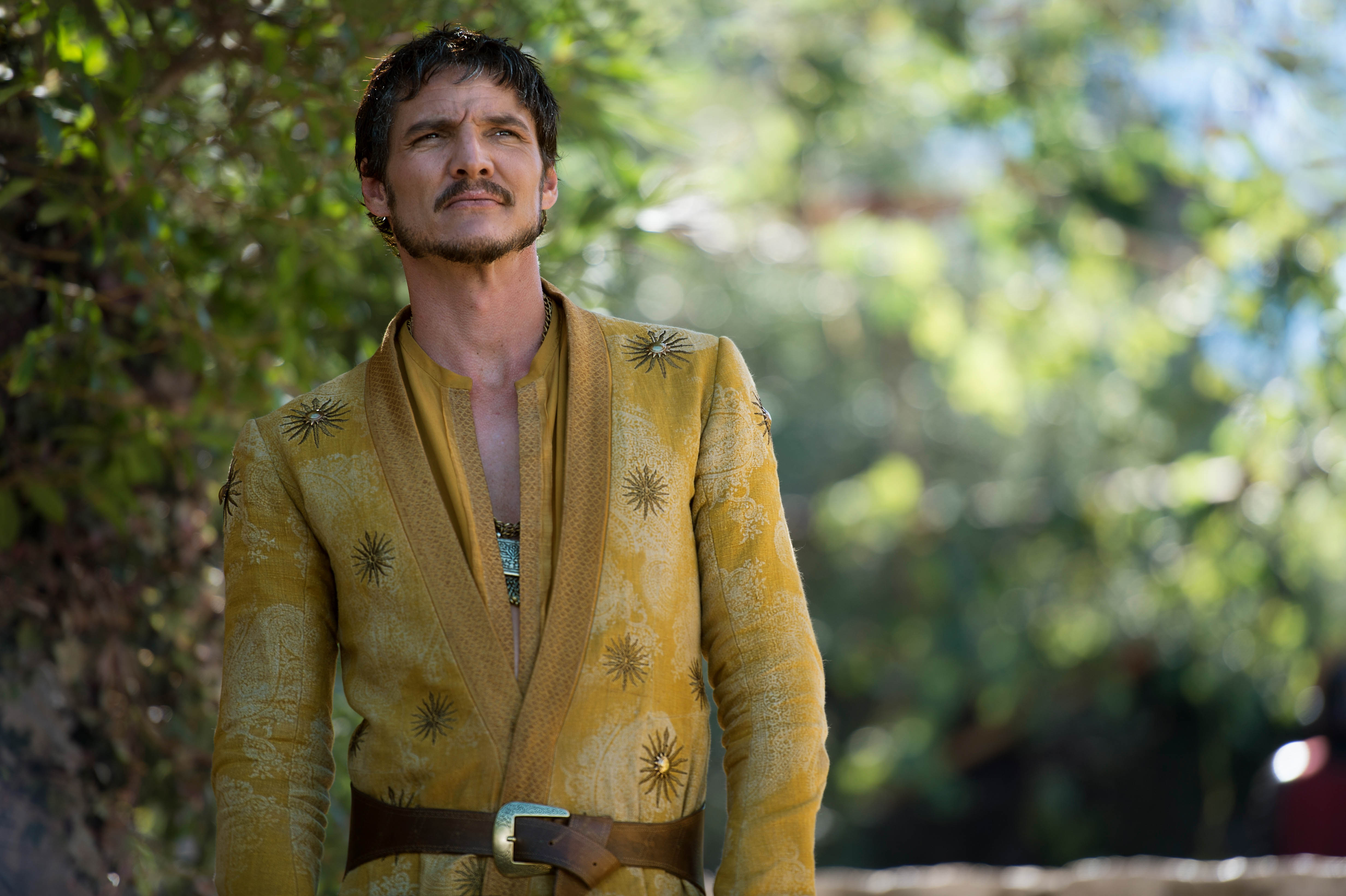 Pedro Pascal in Game of Throes yellow robe