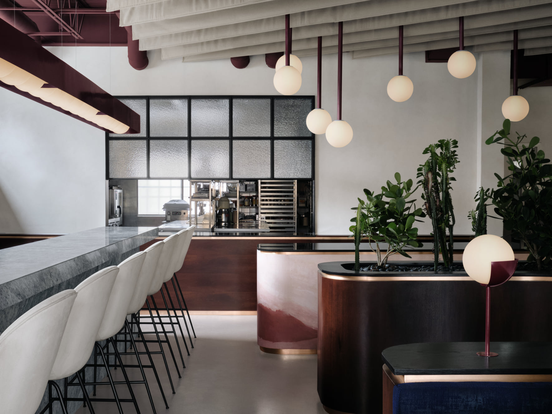 restaurant dining room with greys, pink and red colors