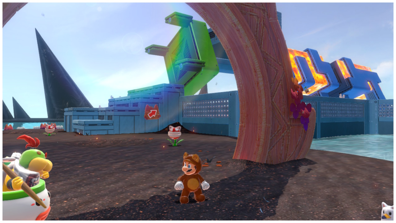 Tanooki Mario stands under a gate to Rolling Roller Isle