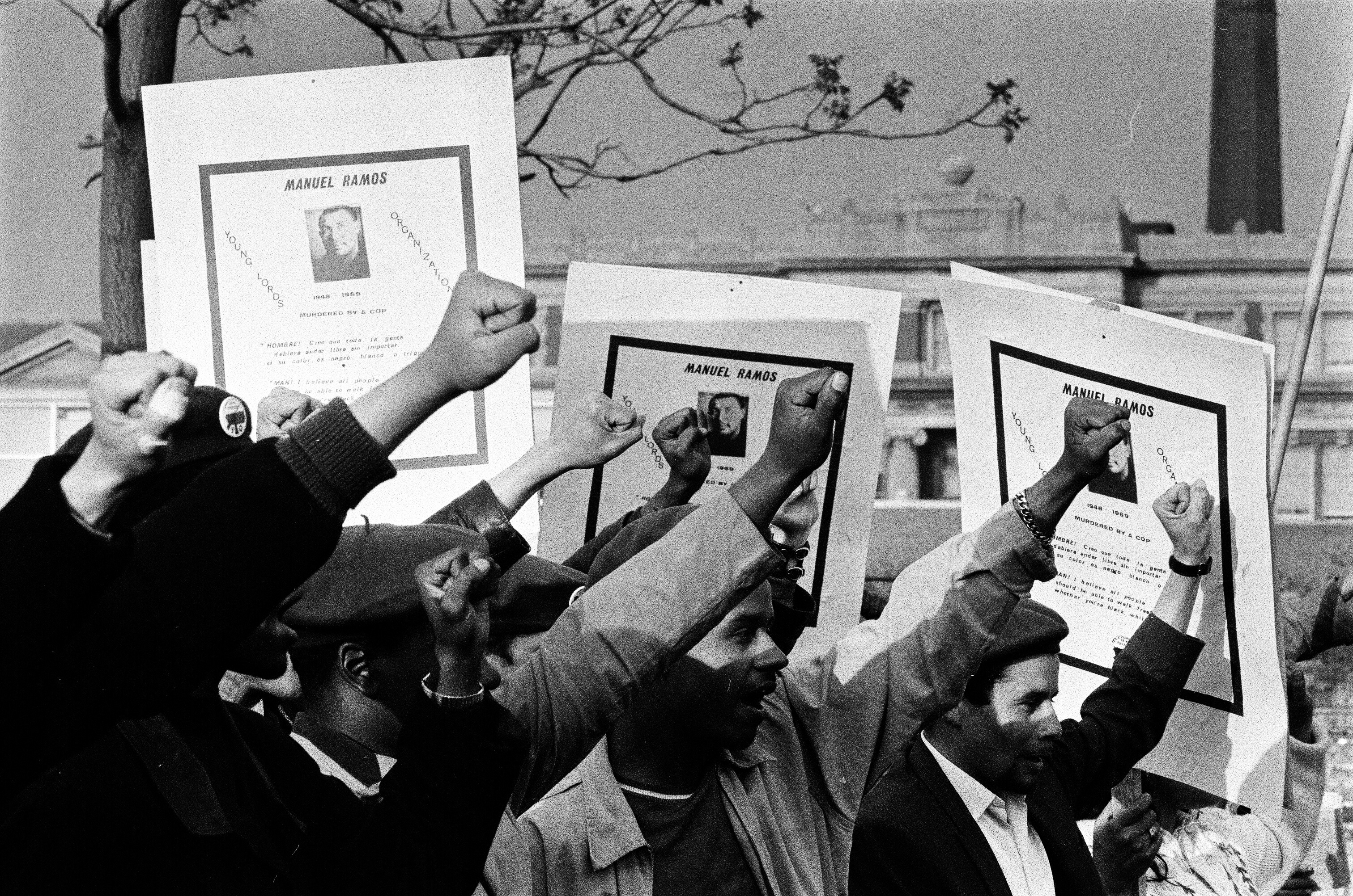 Members of the Young Lords, Black Panthers and Young Patriots march in protest over the fatal shooting of Manuel Ramos by an off-duty Chicago police officer.