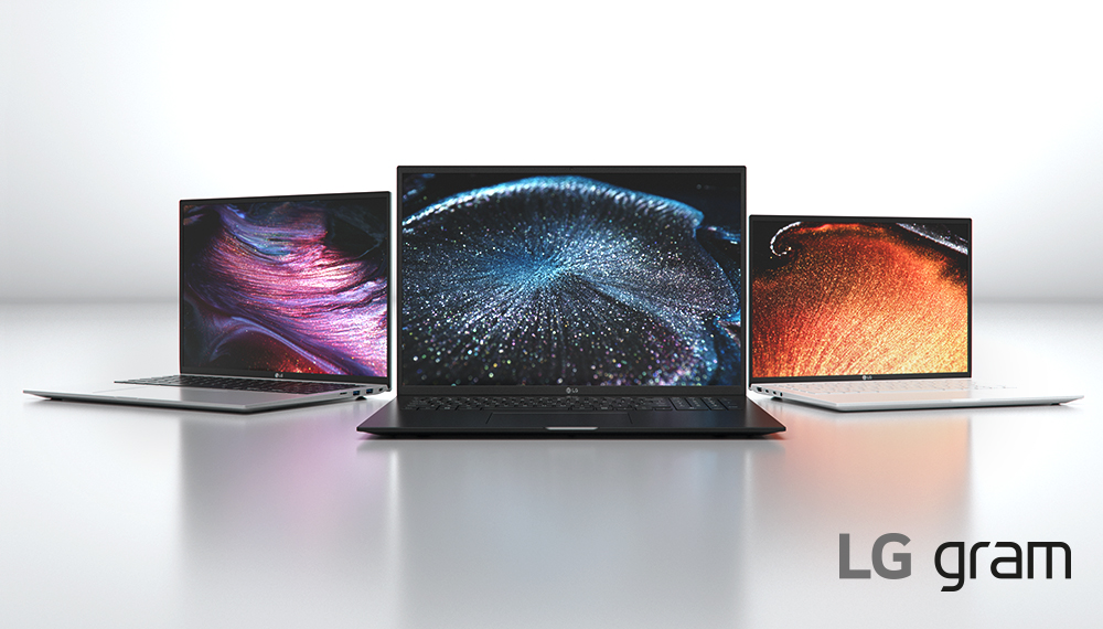 Three LG Gram laptops open, facing the camera in a convex semicircle. Each screen displays a space image.