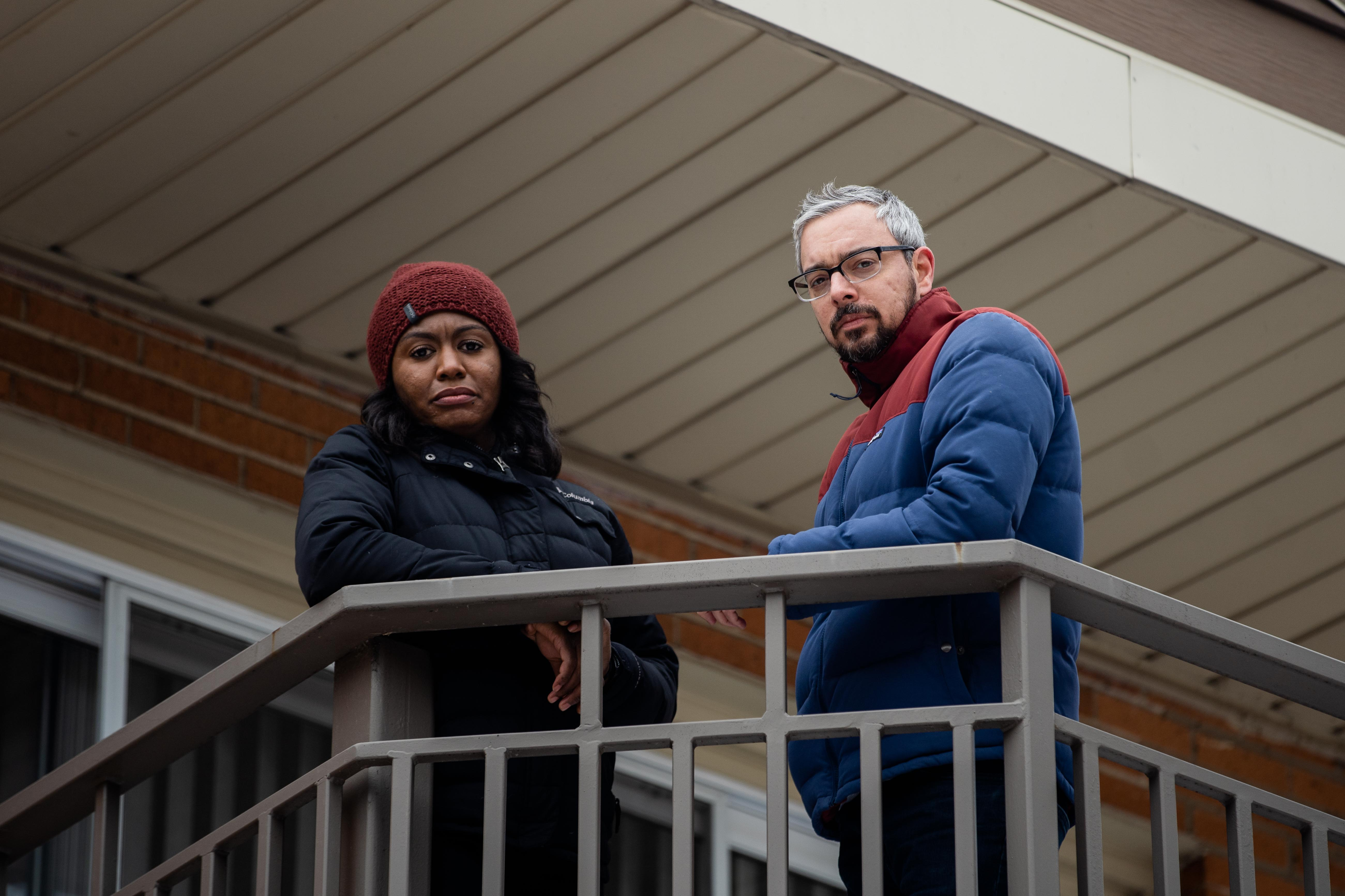 Ashley Holmes and Dave Papish on the balcony of their Rogers Park condo. Just as the coronavirus pandemic hit, they faced a new problem: a violent squatter next door who wouldn't leave and couldn't be forced to.