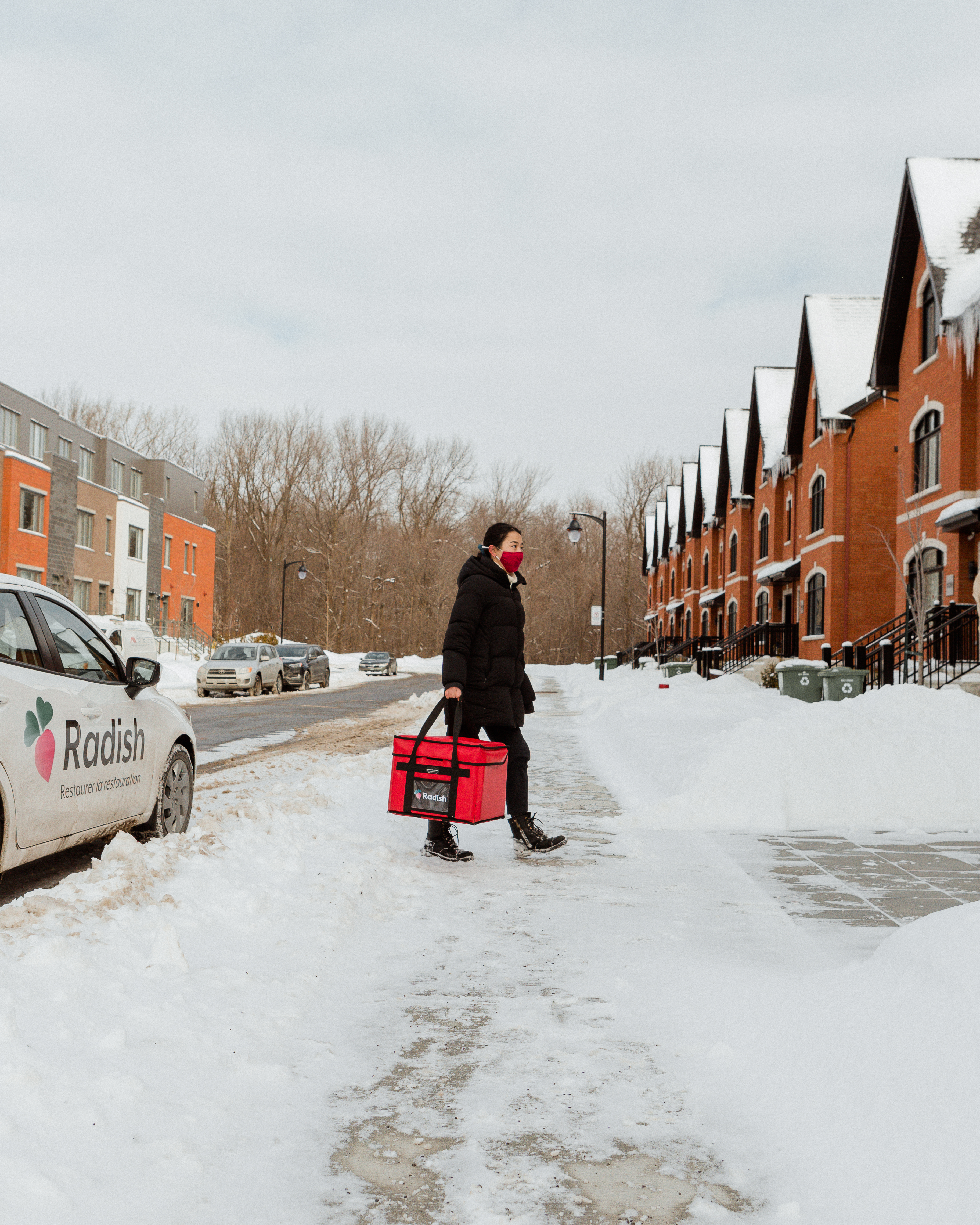 woman delivering food in winter