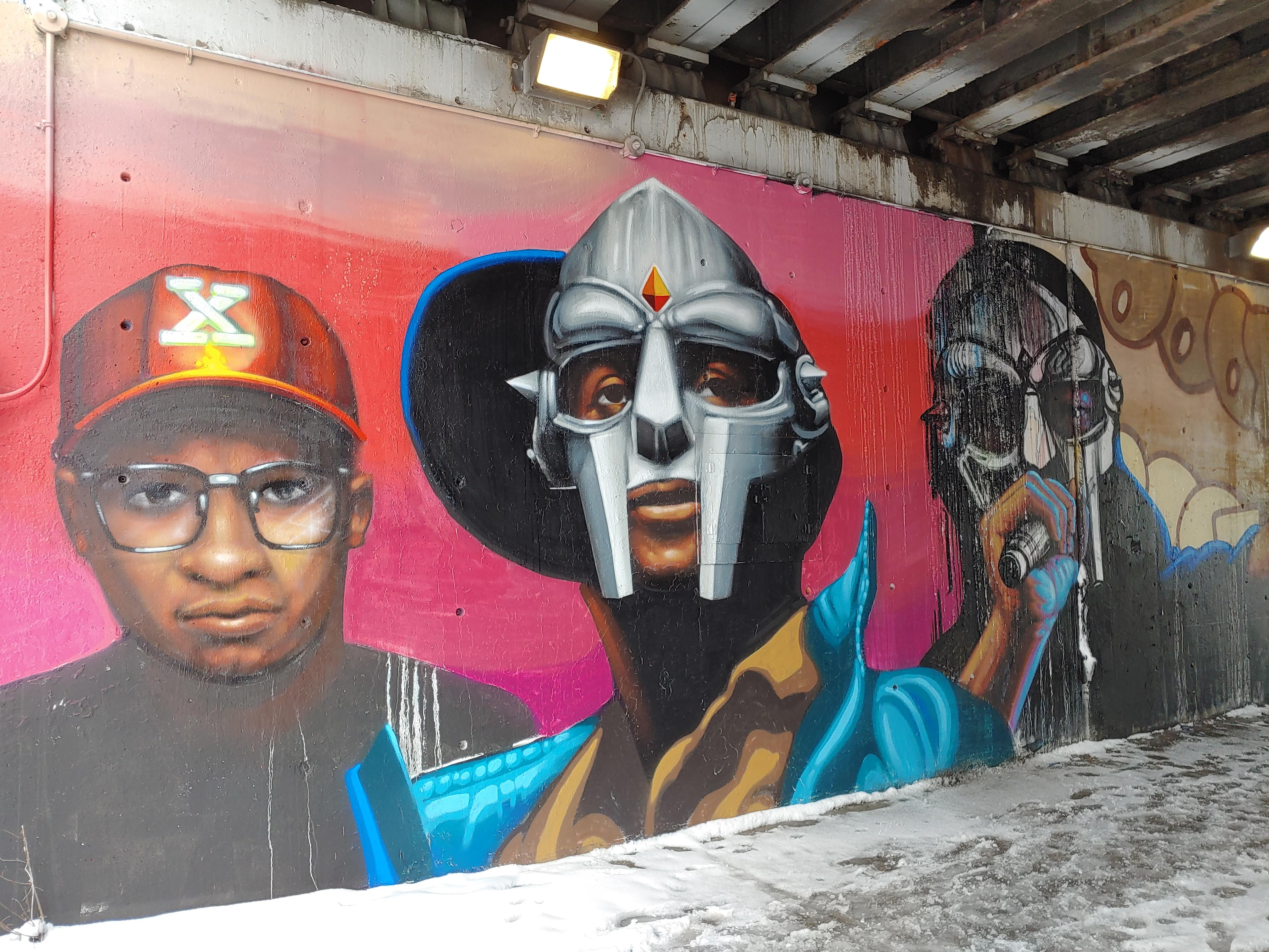This new mural near Hubbard Street in the West Loop by Chicago artist Rahmaan Statik shows three versions of Daniel Dumile, the late rapper and hip-hop artist better known as MF DOOM.