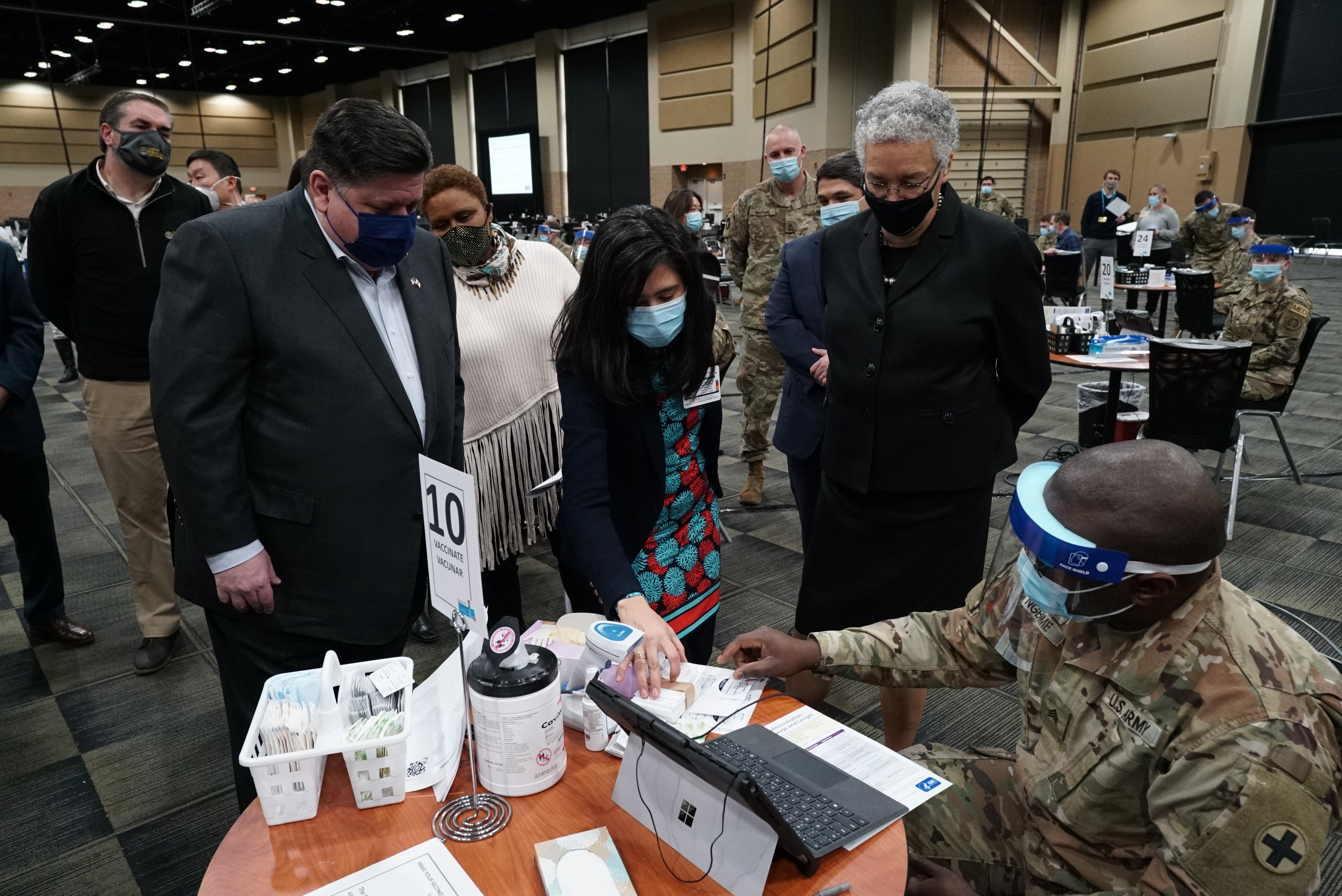 Gov. J.B. Pritzker, Cook County Board President Toni Preckwinkle and other elected official at a  large-scale vaccination in the Tinley Park Convention Center last month.