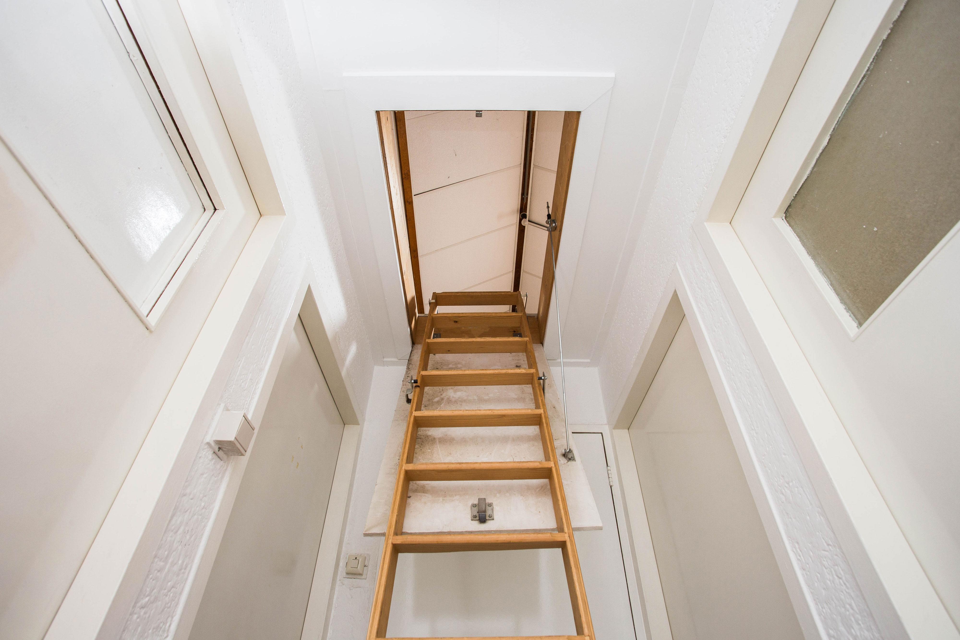 Attic door open with stairs