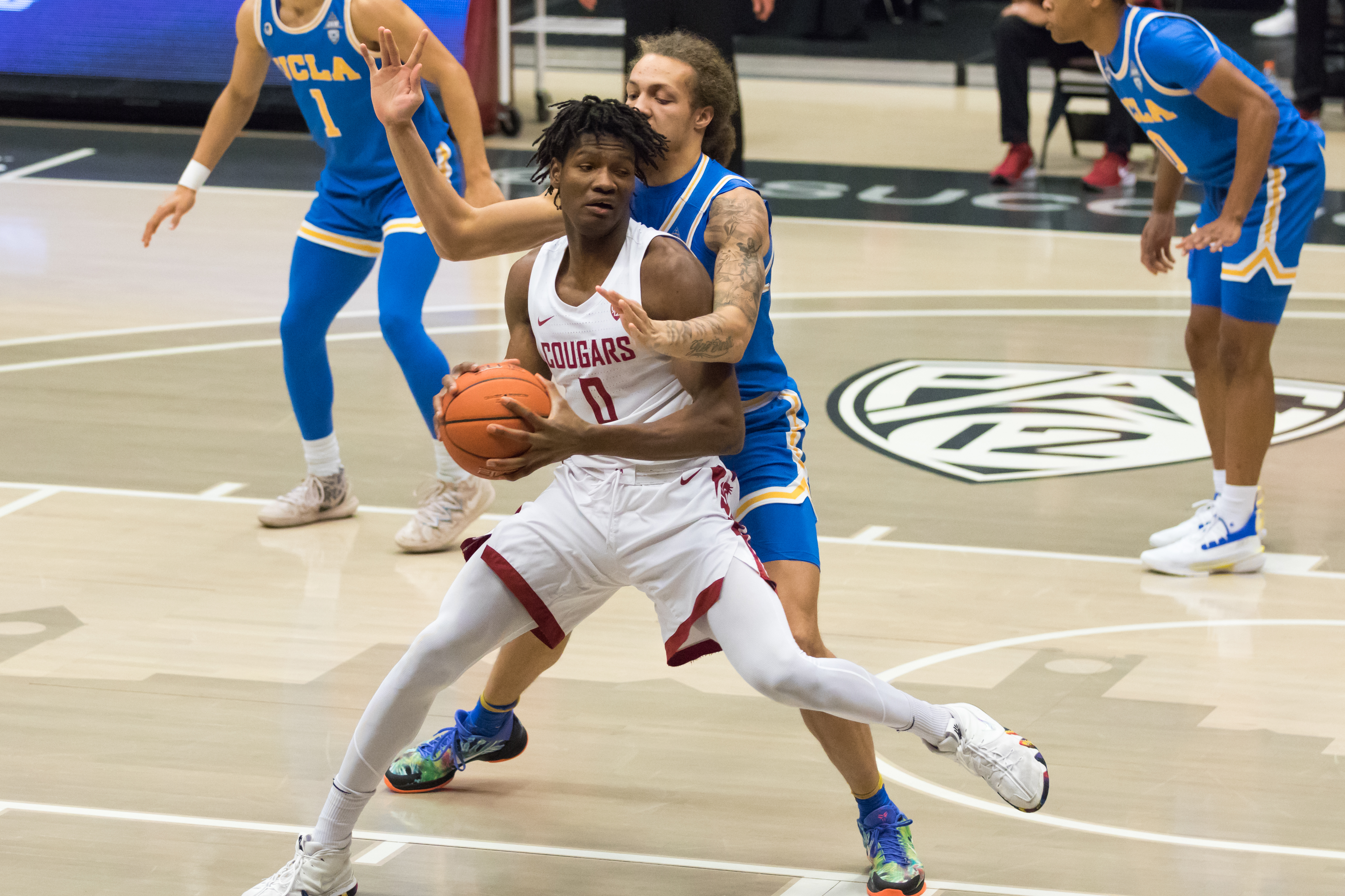 PULLMAN, WA - FEBRUARY 11: Washington State center Efe Abogidi (0) fights through pressure en route to the hoop during the second half of a Pac 12 matchup between the UCLA Bruins and the Washington State Cougars on February 11, 2021, at Beasley Coliseum in Pullman, WA.