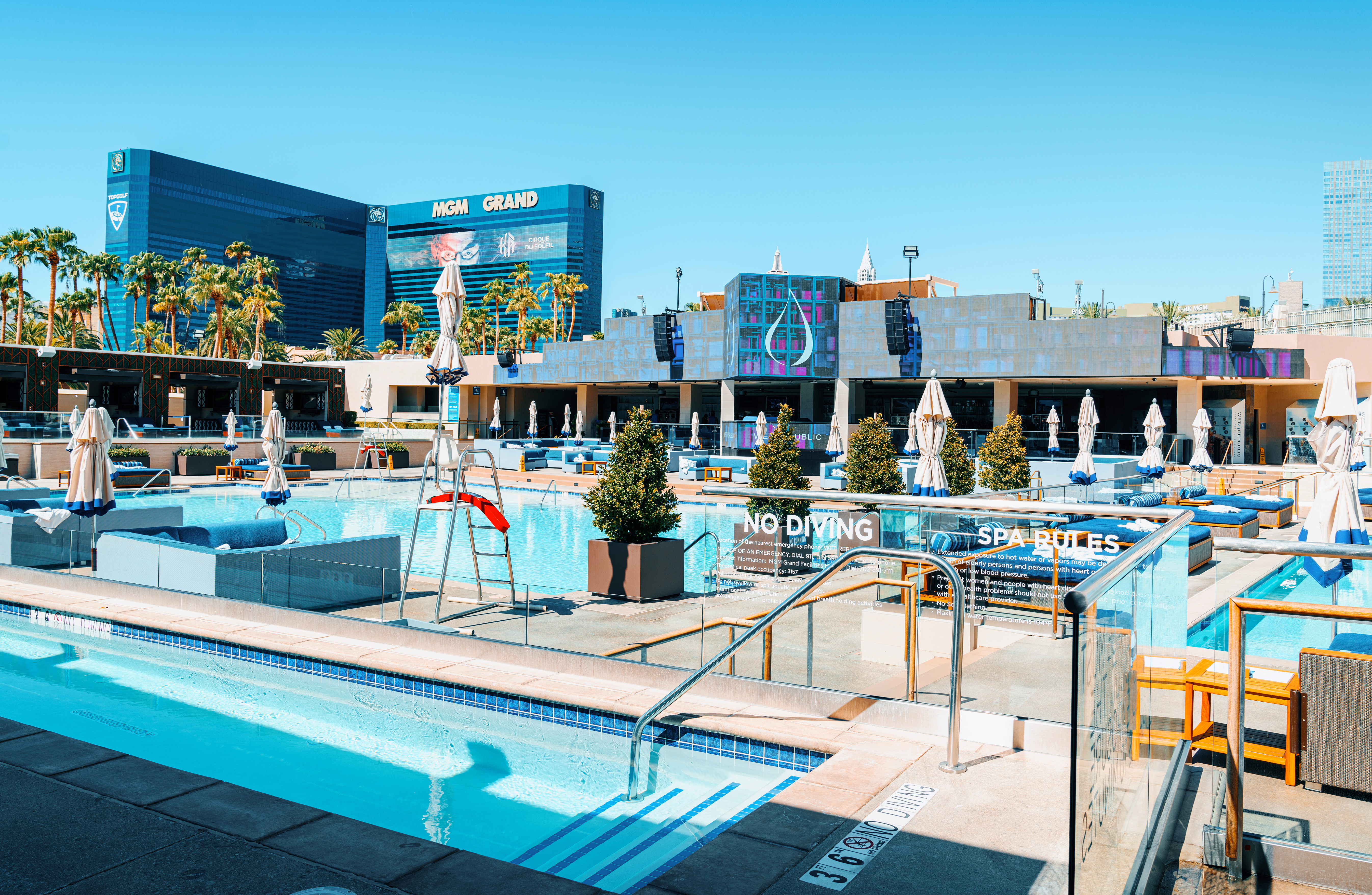 Pools at an outdoor venue with a casino in the background