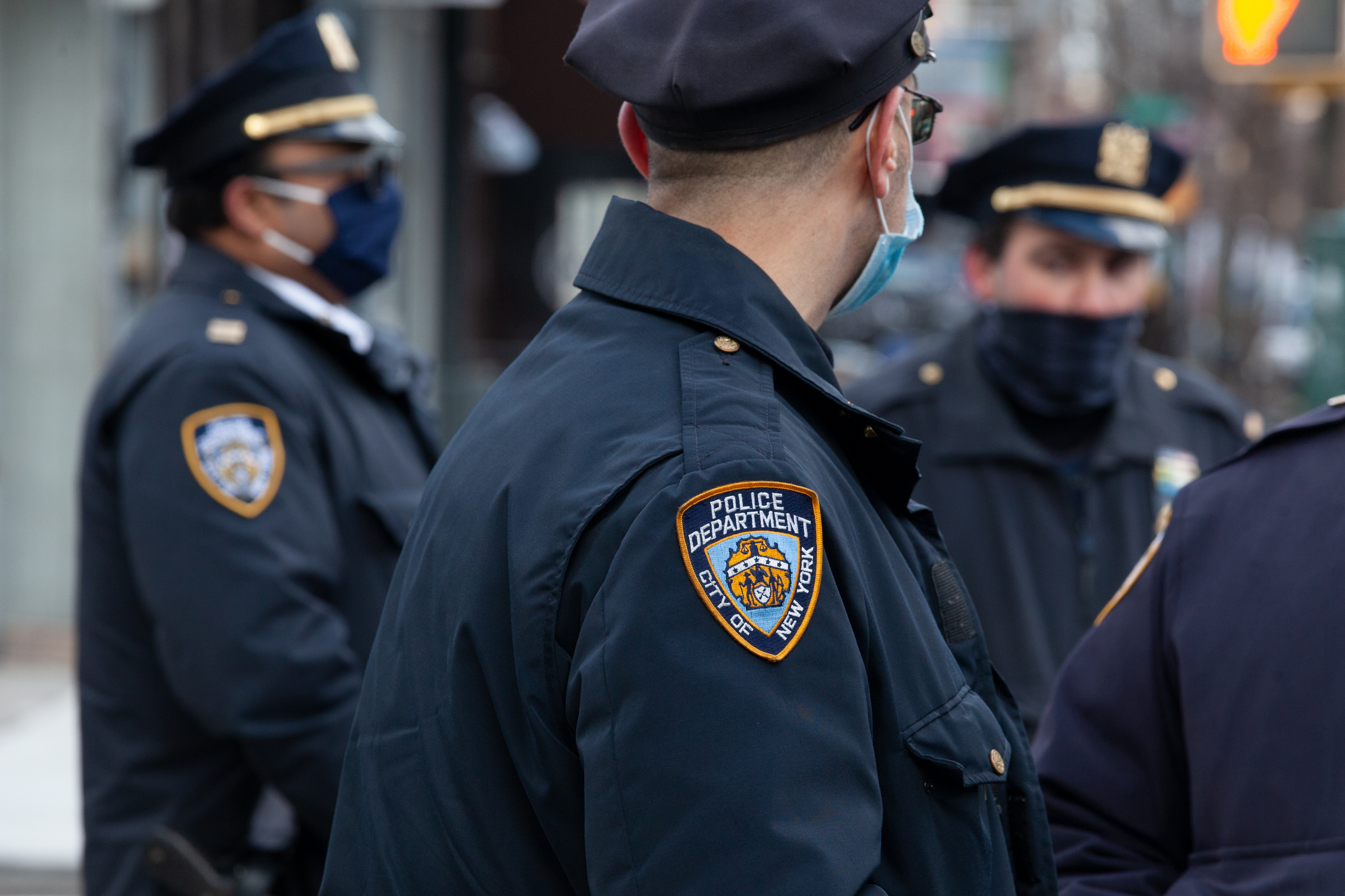 NYPD officers keep watch on a workers' rights protest in Crown Heights, Brooklyn, Jan. 20, 2021.