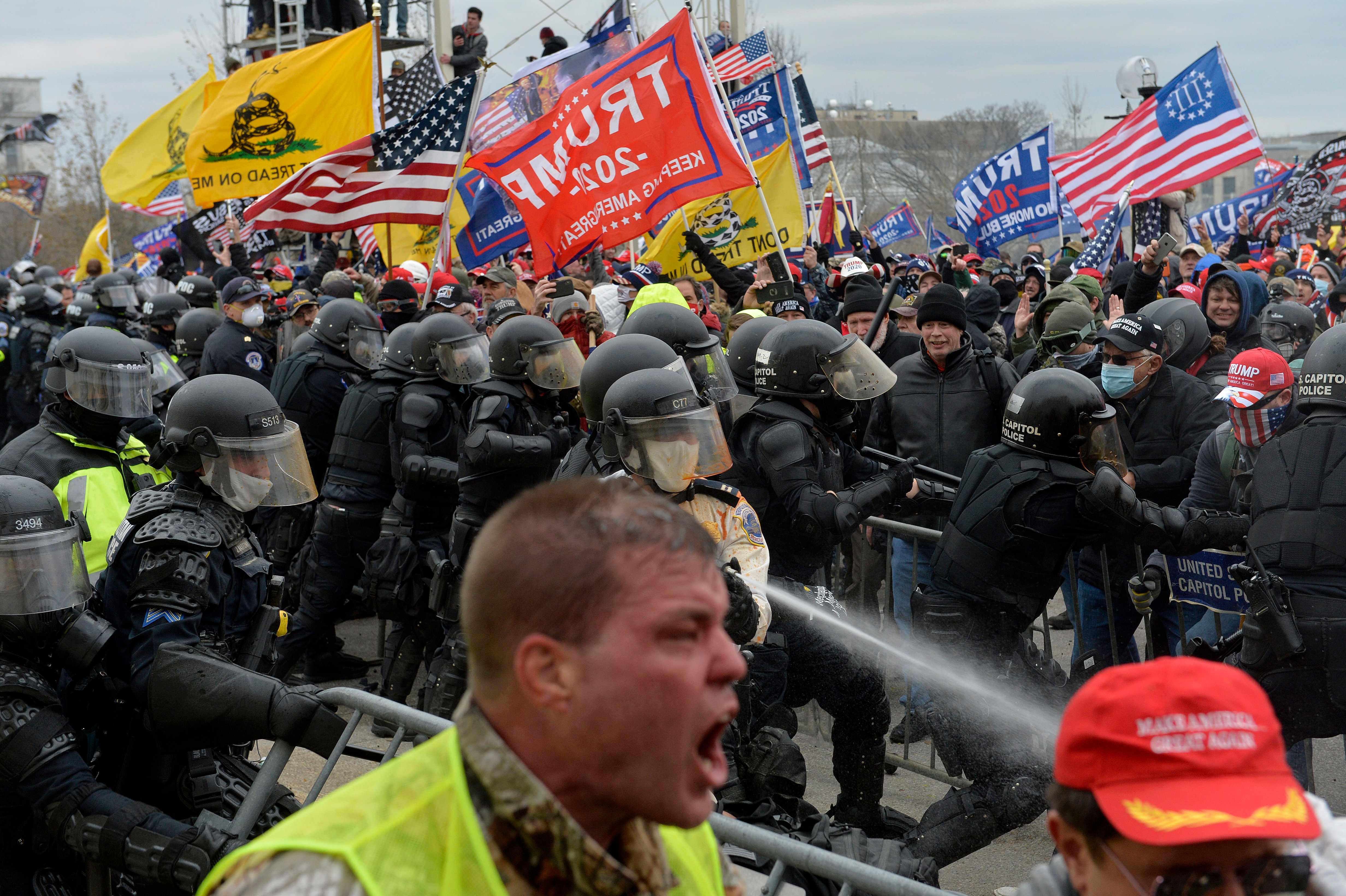 (FILES) In this file photo taken on January 6, 2021 Trump supporters clash with police and security forces as people try to storm the US Capitol in Washington DC. - Facebook on February 11, 2021 said it had tackled abuse on its network surrounding the deadly attack on the US Capitol by supporters of former president Donald Trump. The social network, which has been criticized for allowing some users to orchestrate violence that played out on January 6, also said it fed information to law enforcement agencies during the insurrection. (Photo by Joseph Prezioso / AFP) (Photo by JOSEPH PREZIOSO/AFP via Getty Images) ORG XMIT: 0