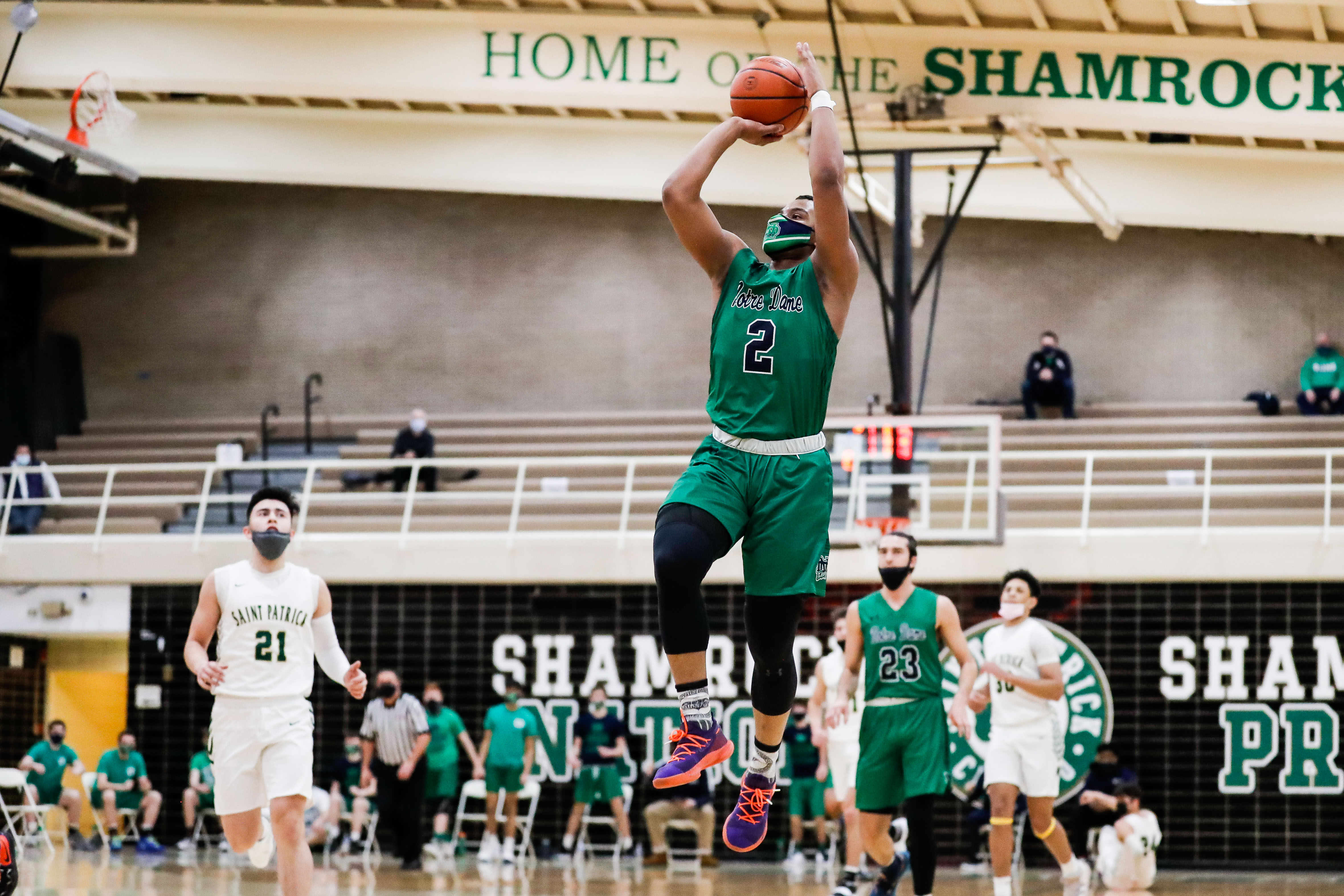Notre Dame's Anthony Sayles (2) jumps in the air to shoot against St. Patrick.