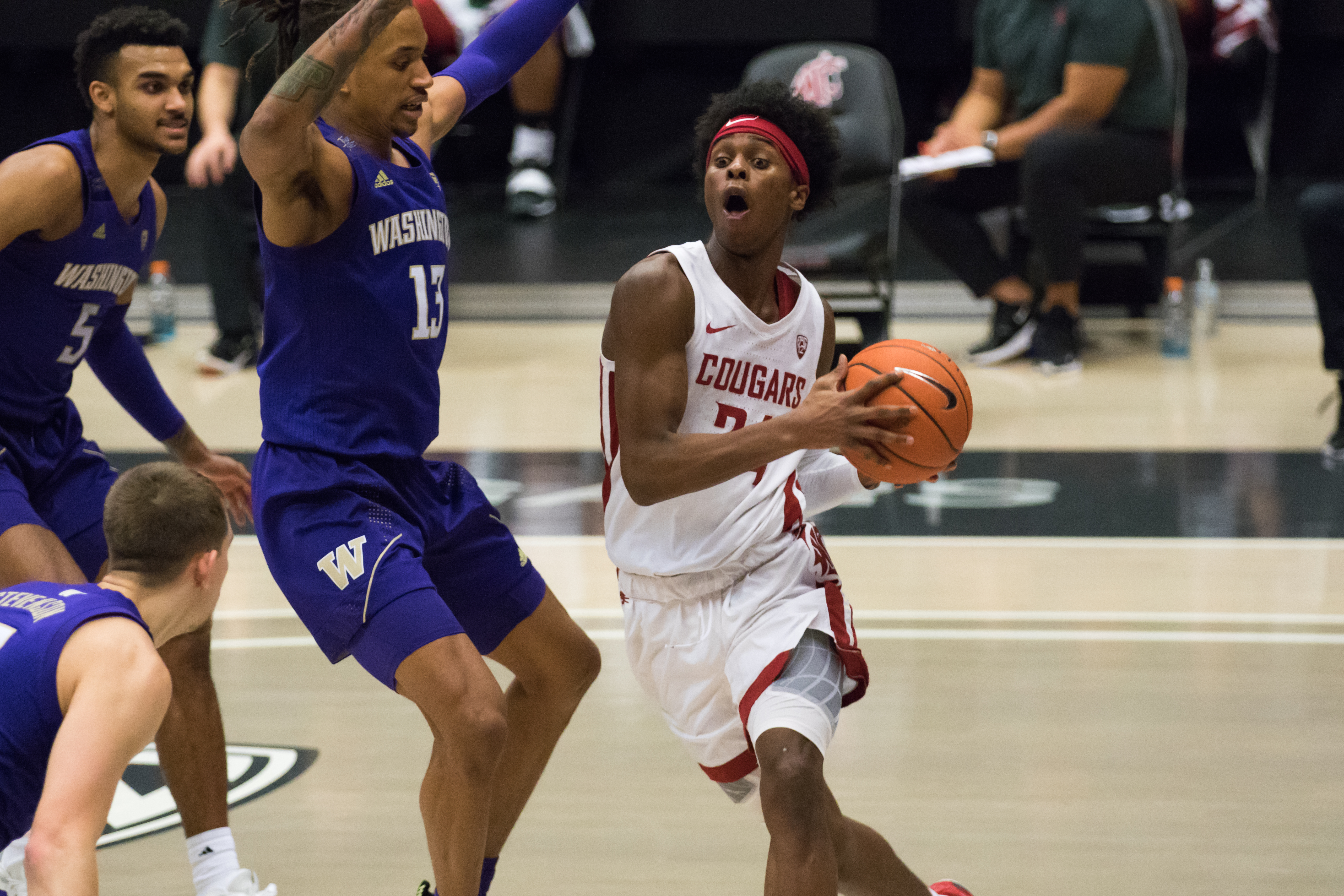 PULLMAN, WA - FEBRUARY 15: Washington State guard Noah Williams (24) drives down the baseline during the second half of a Pac 12 matchup between the Washington Huskies and the Washington State Cougars on February 15, 2021, at Beasley Coliseum in Pullman, WA.