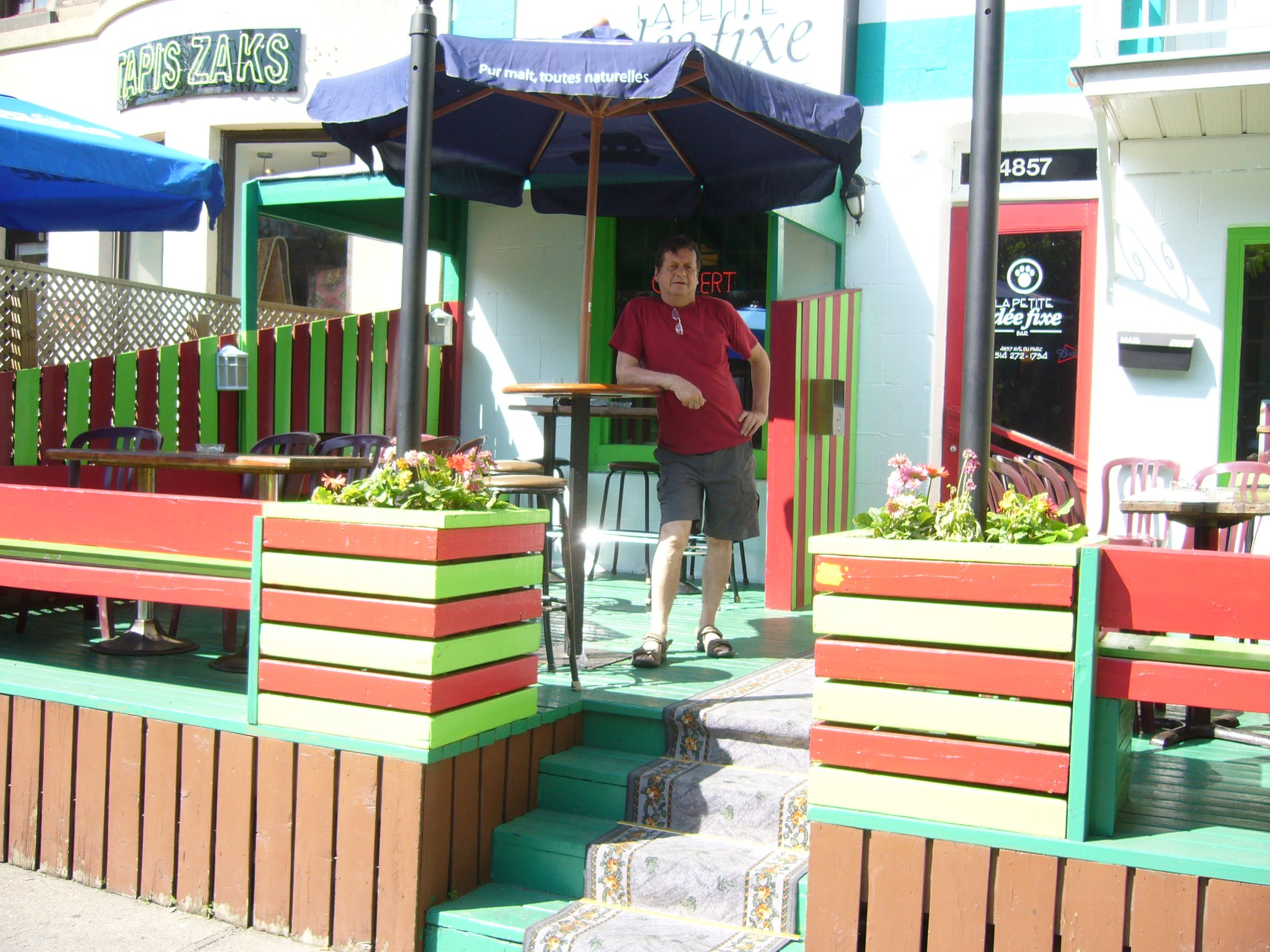man standing in front of bar