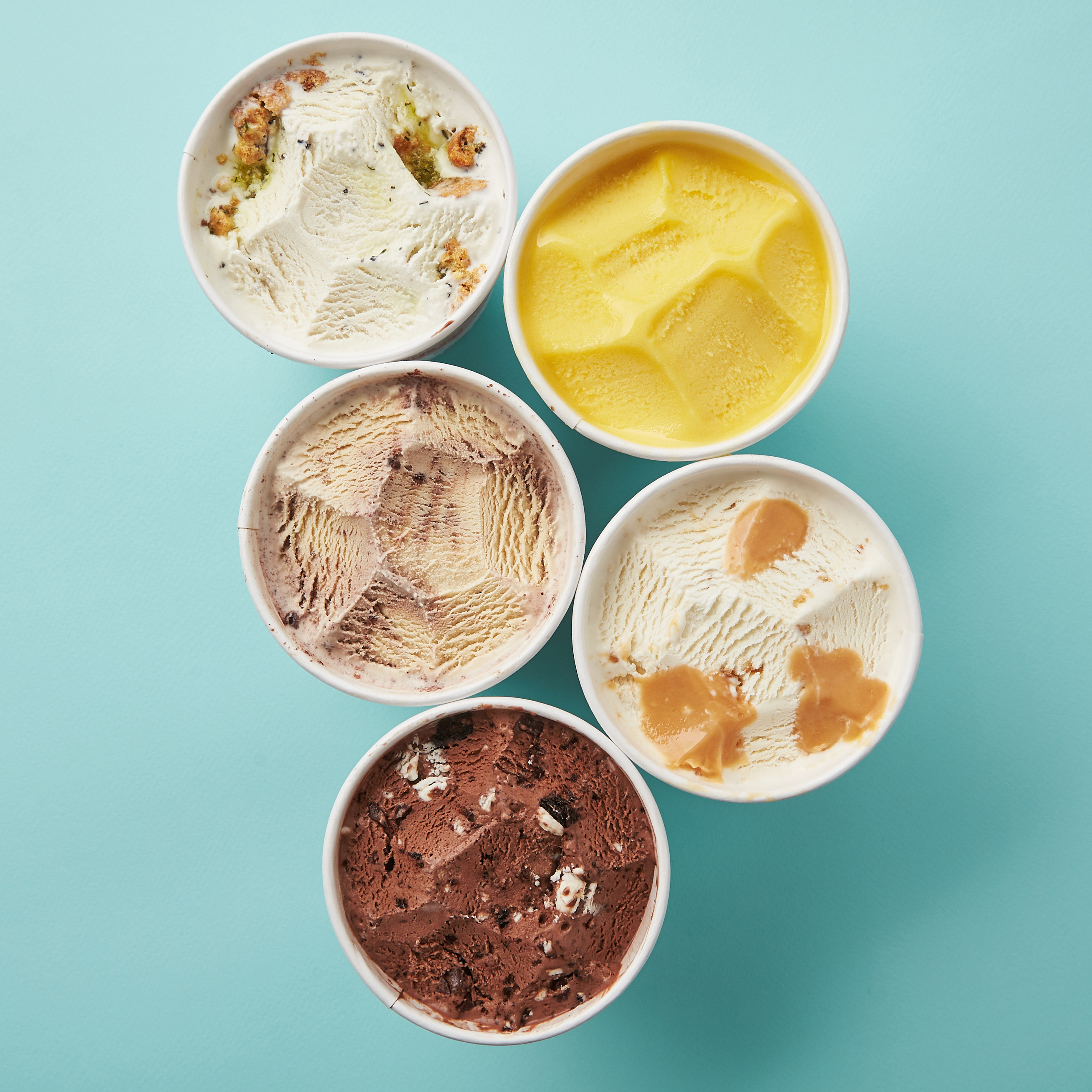 Five pints of ice cream sitting next to each in bright colors