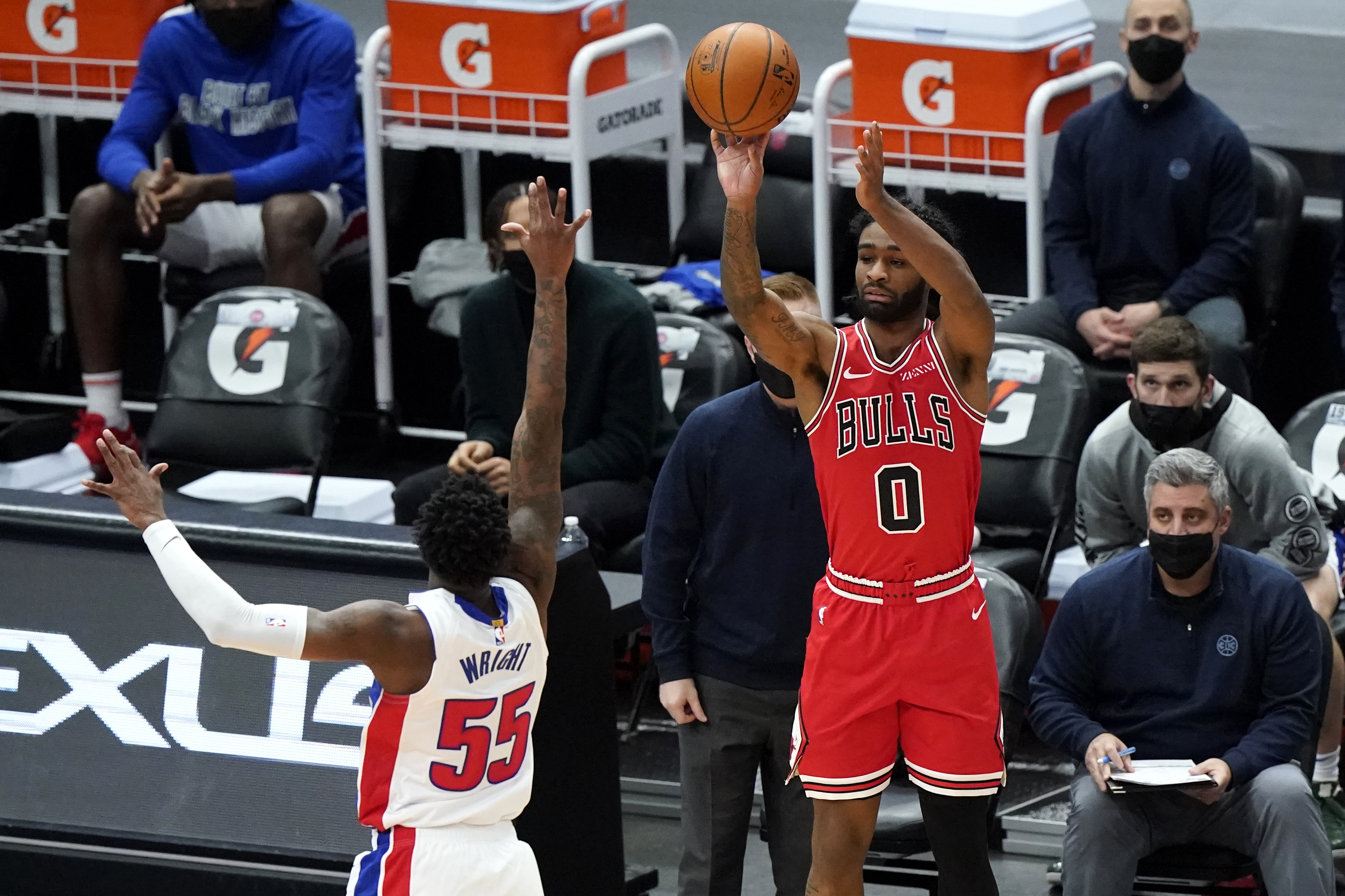 Bulls guard Coby White, right, shoots over Pistons guard Delon Wright during the second half Wednesday night.