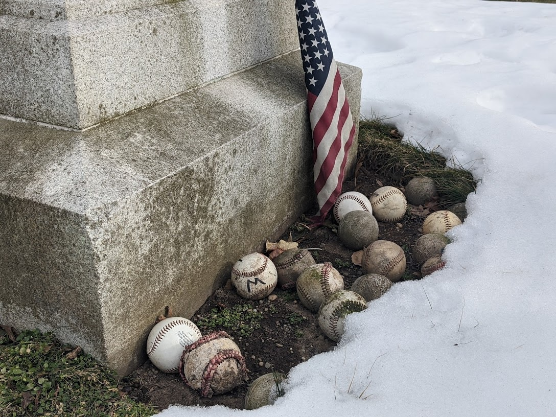 Baseballs left at the monument